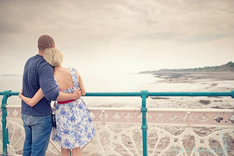 Cwtching on Penarth Pier - engagement photography