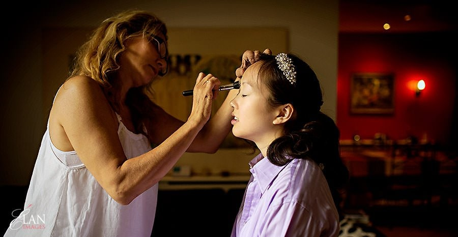 Bride having her make up applied by mel kinsman, before her wedding at Notting Hill, London