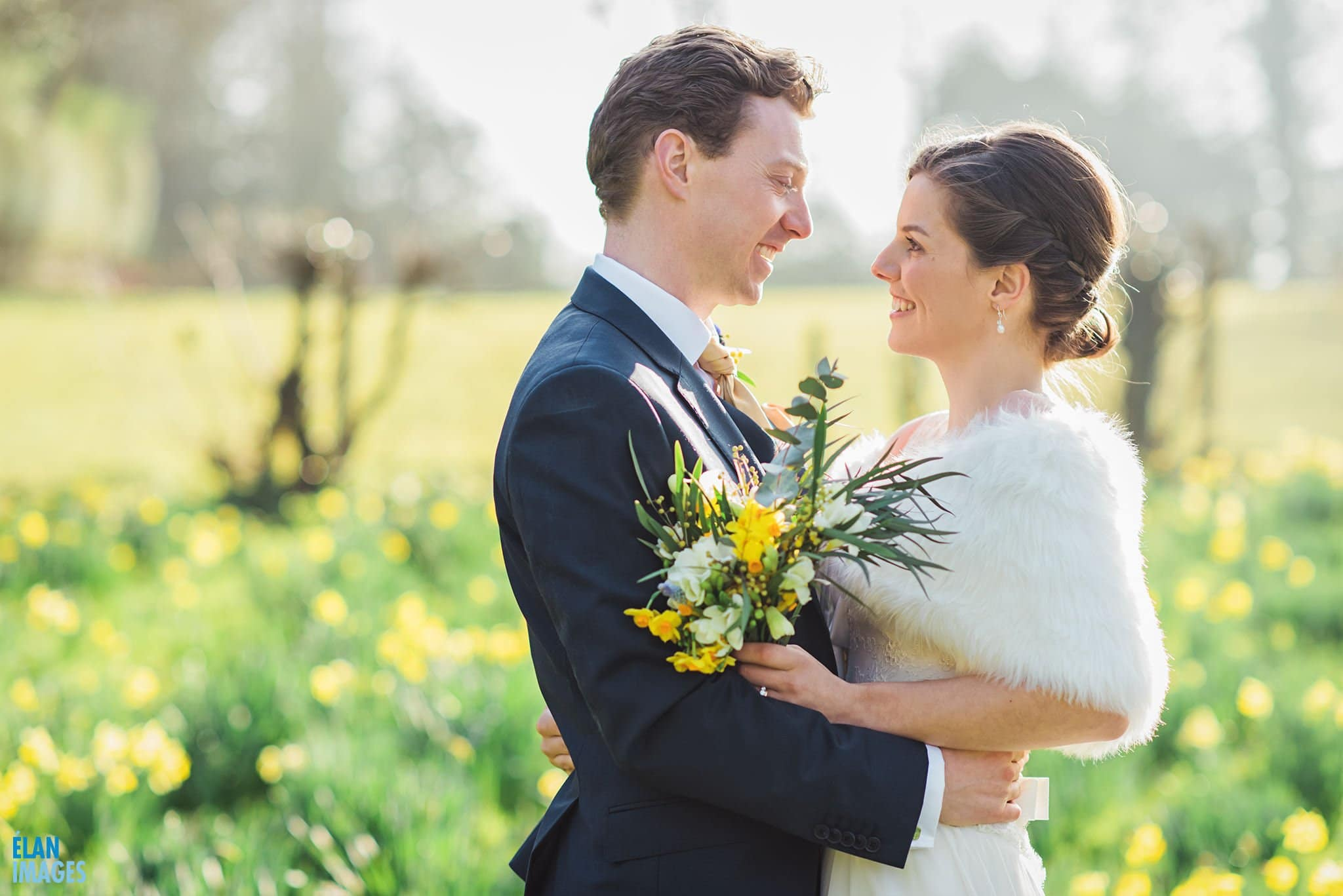 Bride and Groom in the Daffodils at Coombe Lodge