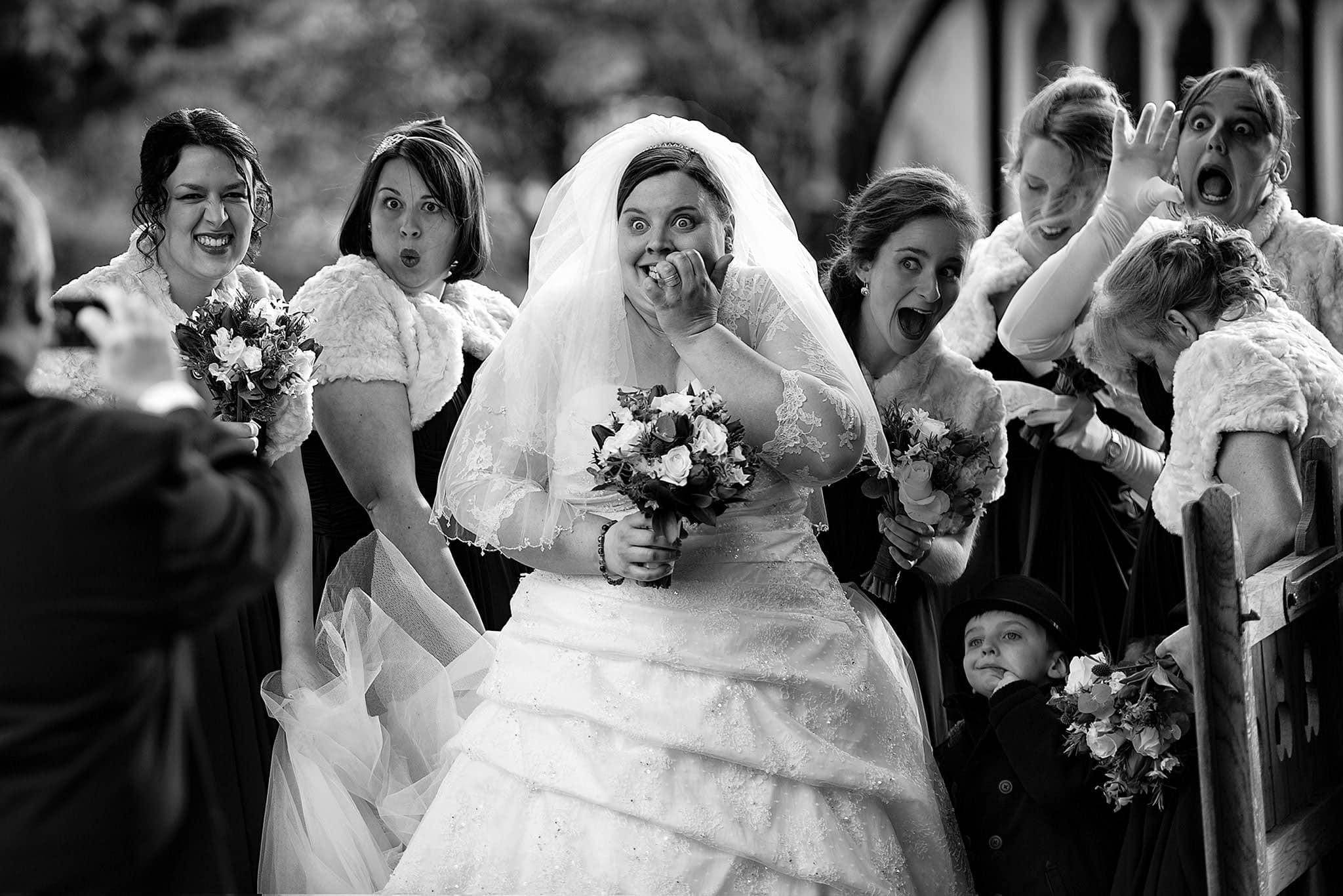 Bride laughing with bridesmaids before wedding in Oxford