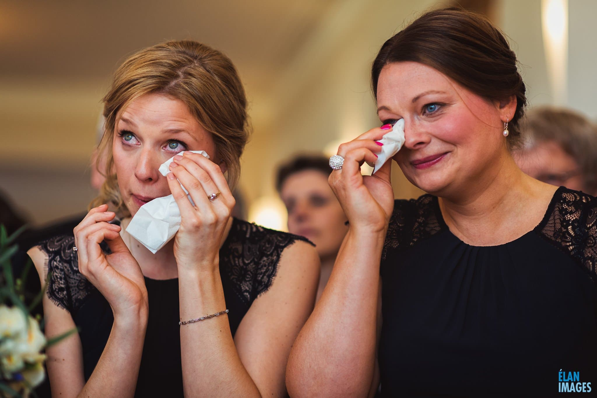 Emotional bridesmaids during a wedding ceremony at Coombe Lodge