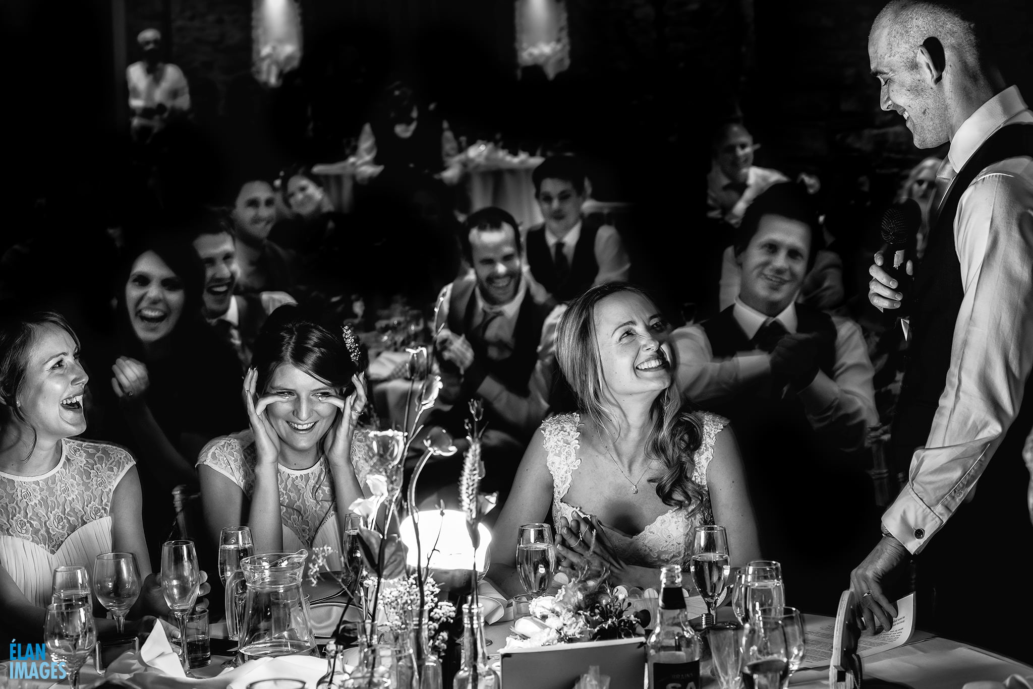 Great Tythe Barn Wedding Reception - Bride and Groom laughing with guests
