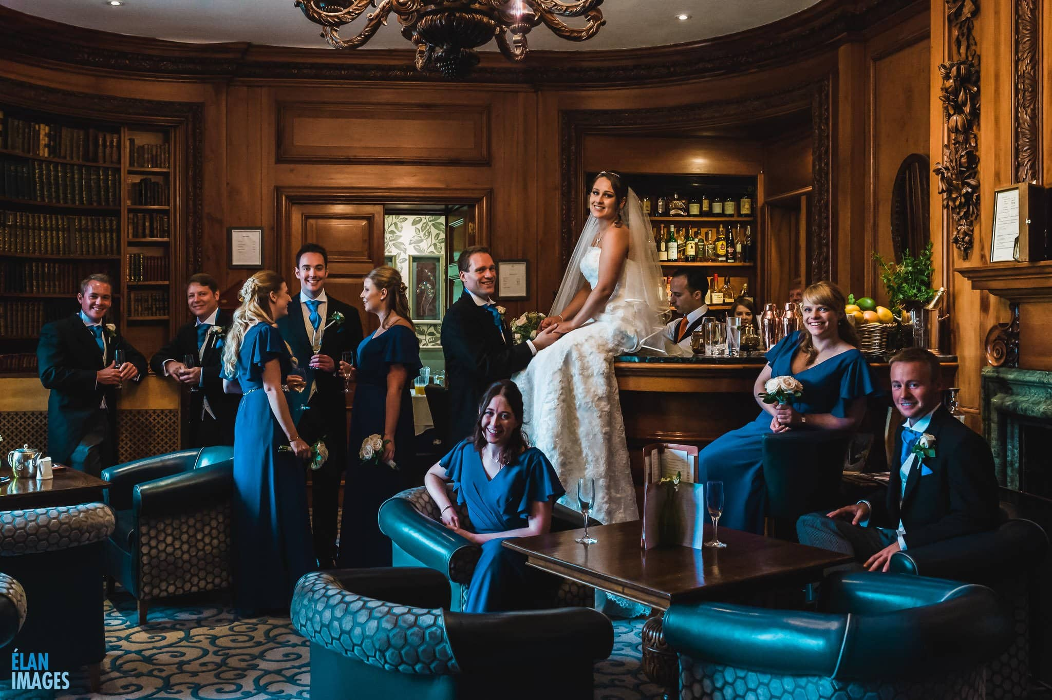 Lainston House Wedding Photography - The Bridal party photographed in the bar