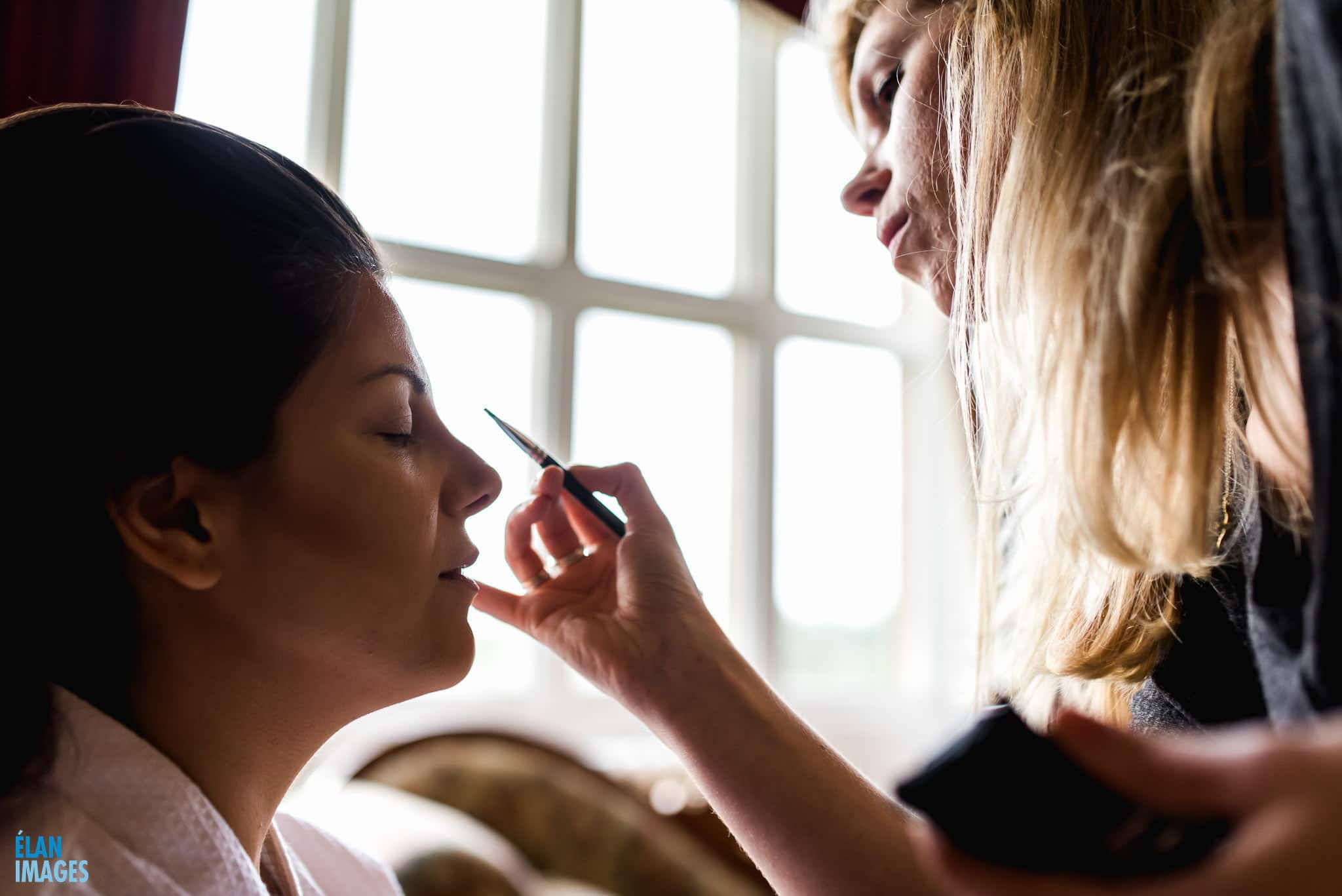The bride having make up applied before her wedding ceremony at Orchardleigh