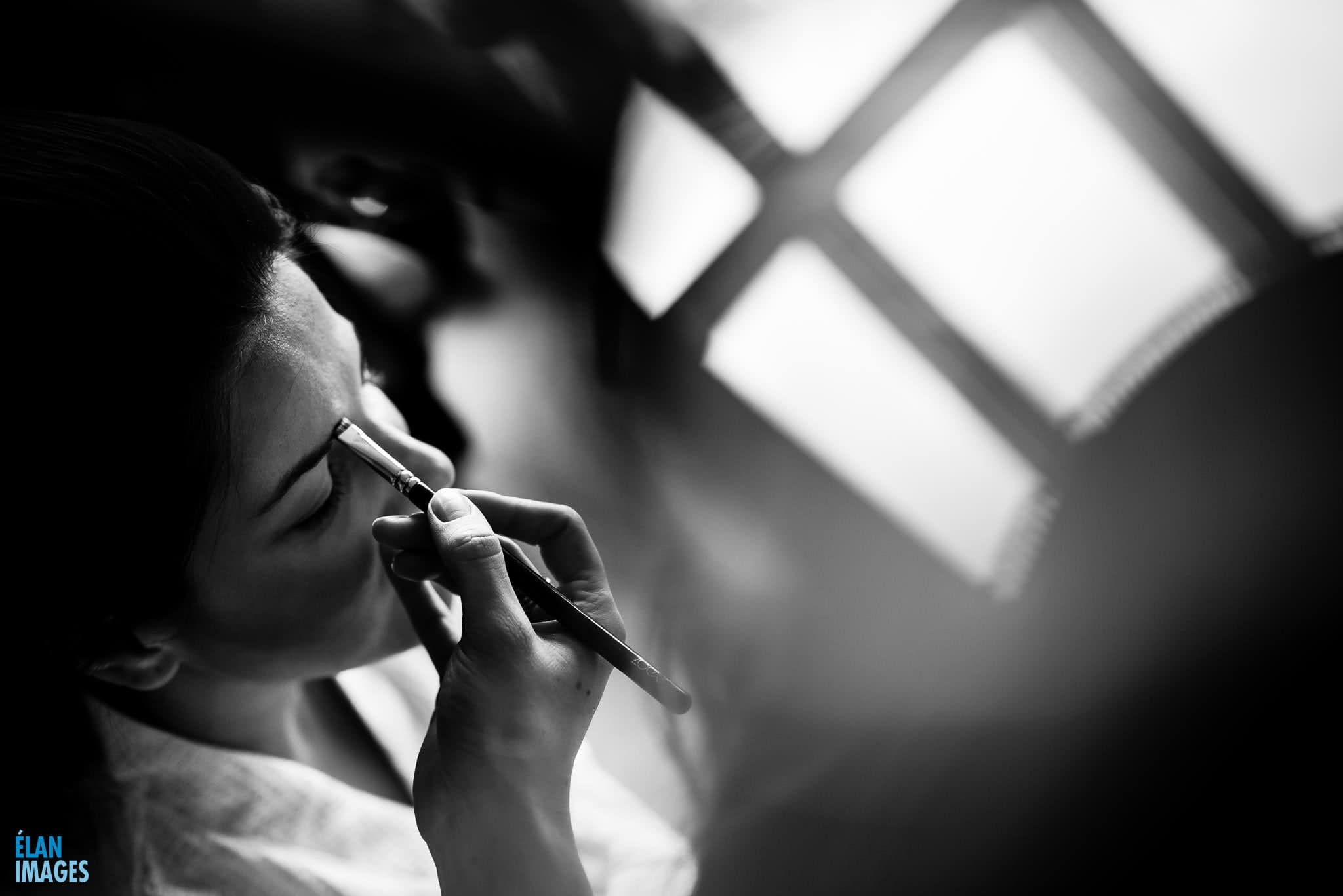 Bride getting ready having her make up applied at Orchardleigh's Bonita bridal suite