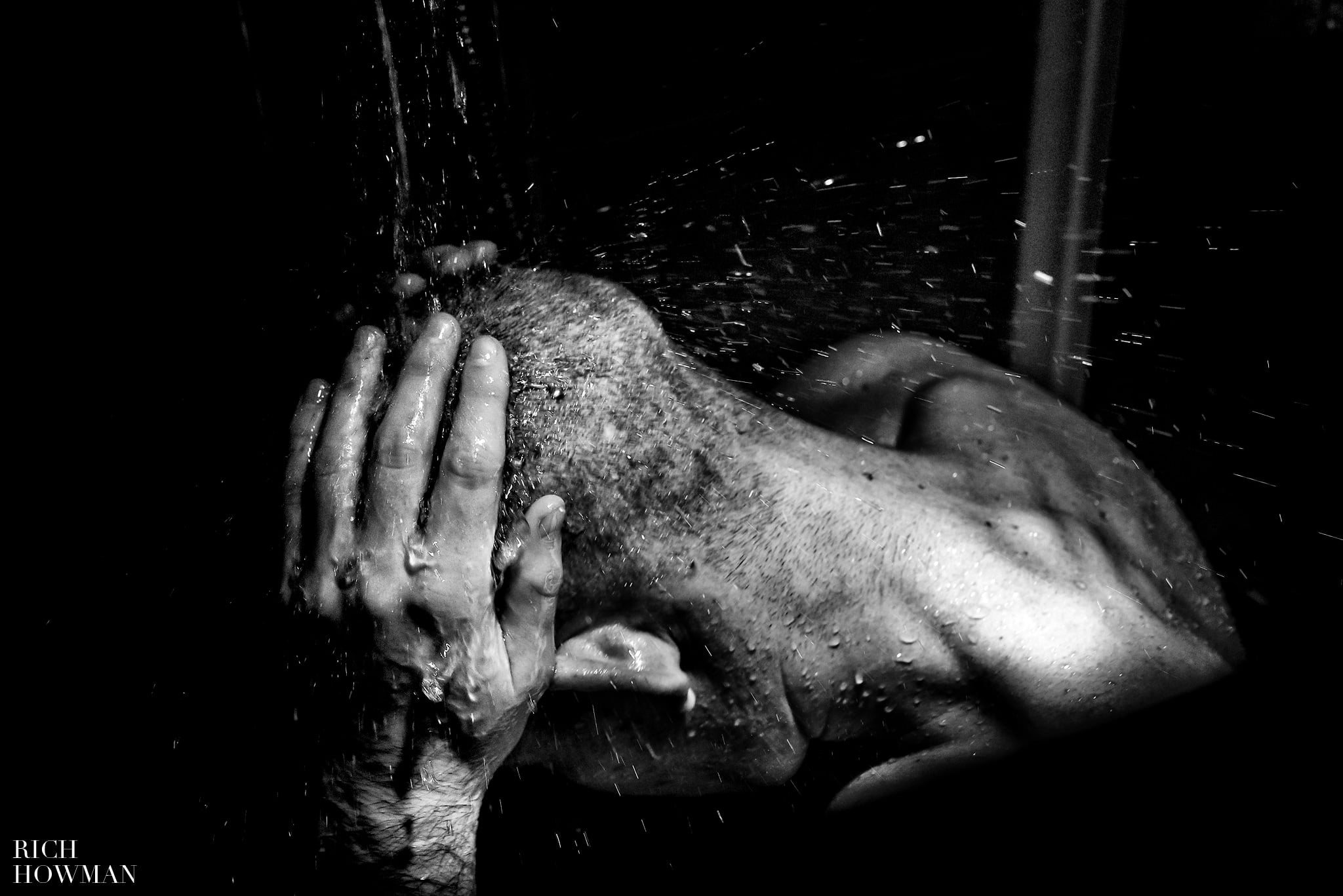 WPJA Award Winning Photograph Groom in the shower Getting Ready