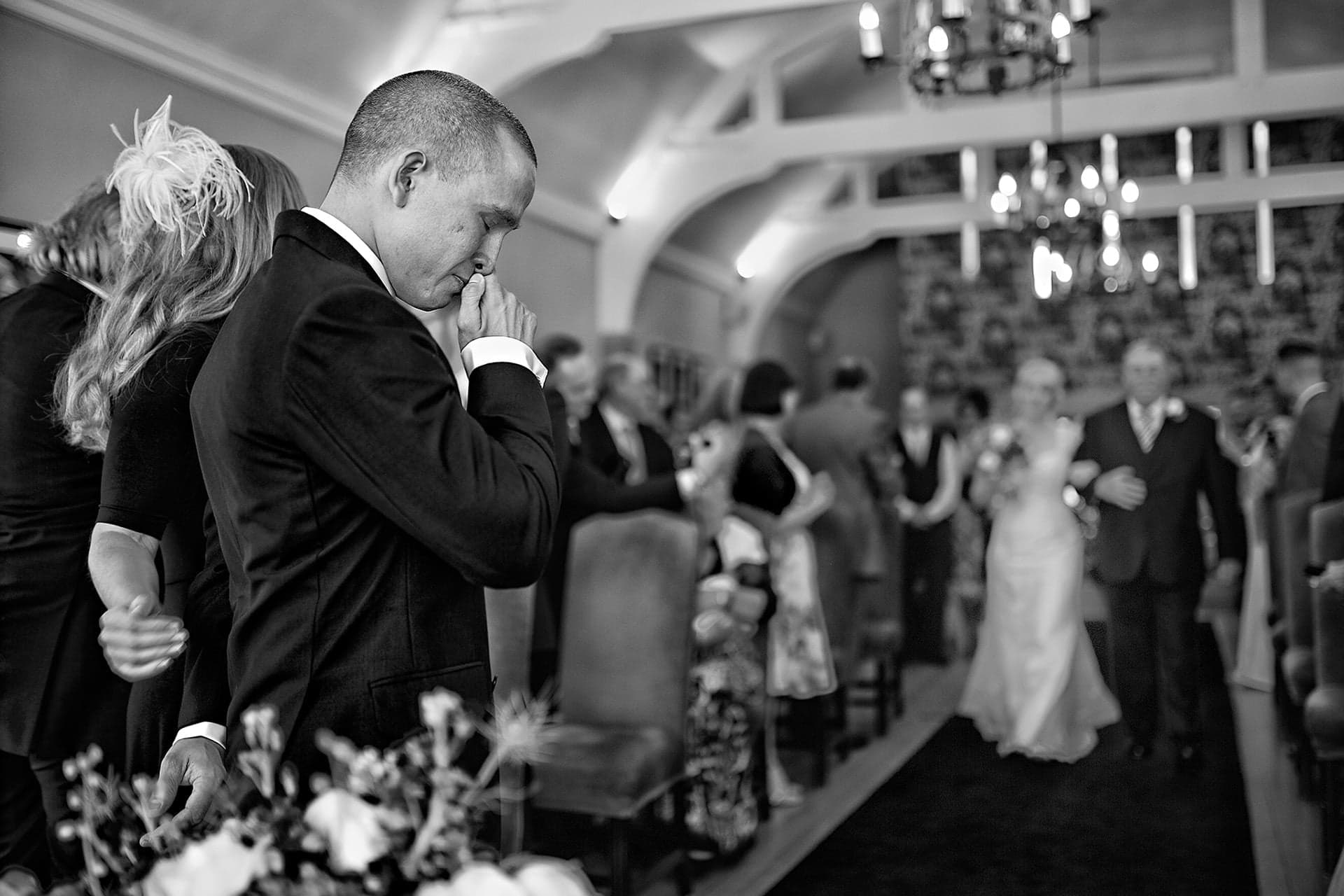 Fearless Photographers Award Winning Wedding Photograph - Matt the groom shortly before getting married as his fiancee walks up the aisle towards him, at the Hare & Hounds Hotel in Westonbirt