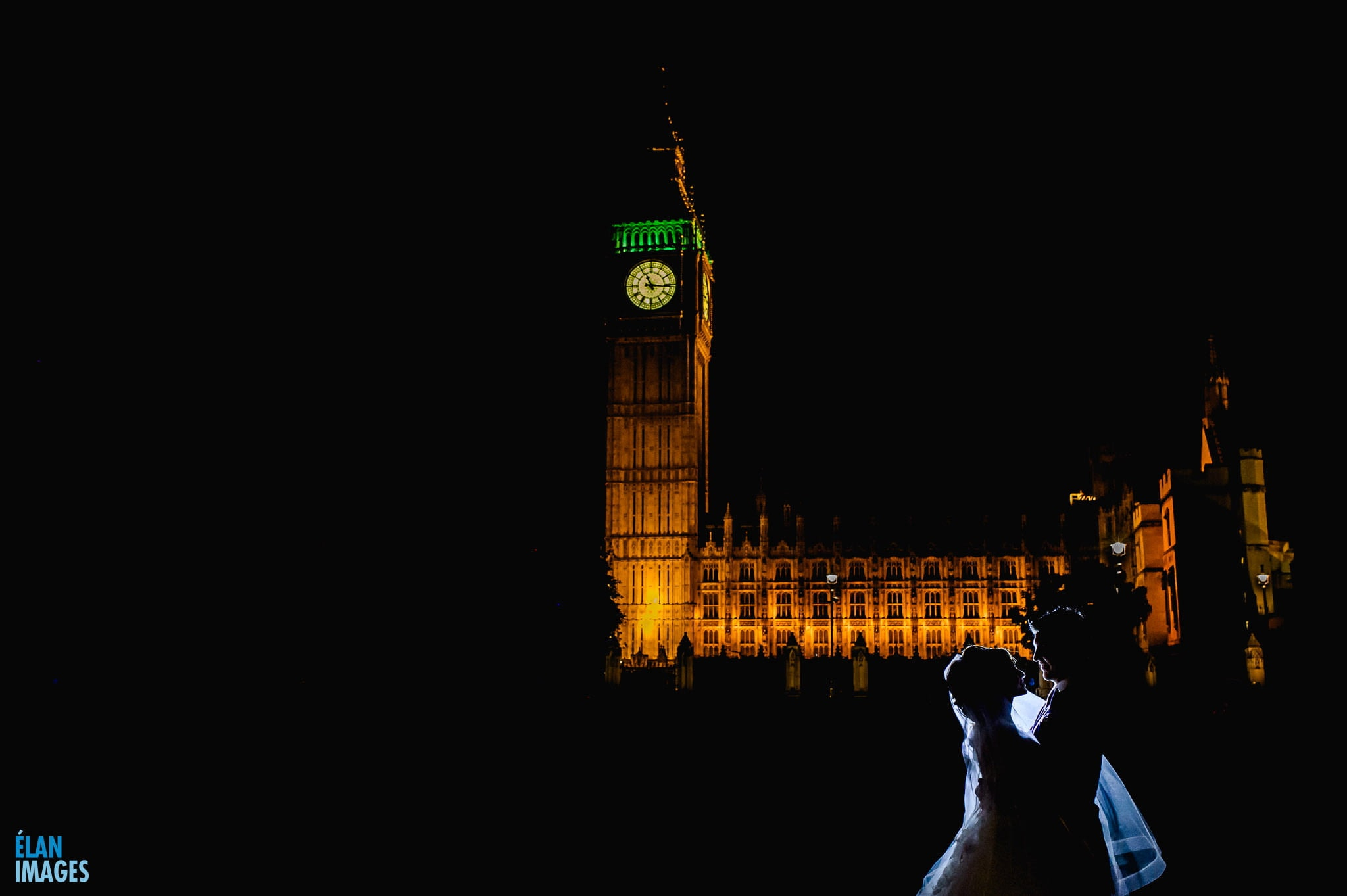 Westminster Wedding Photographer- Wedding at One Great George Street, bride and groom photographed standing outside the Houses of Parliament at Night