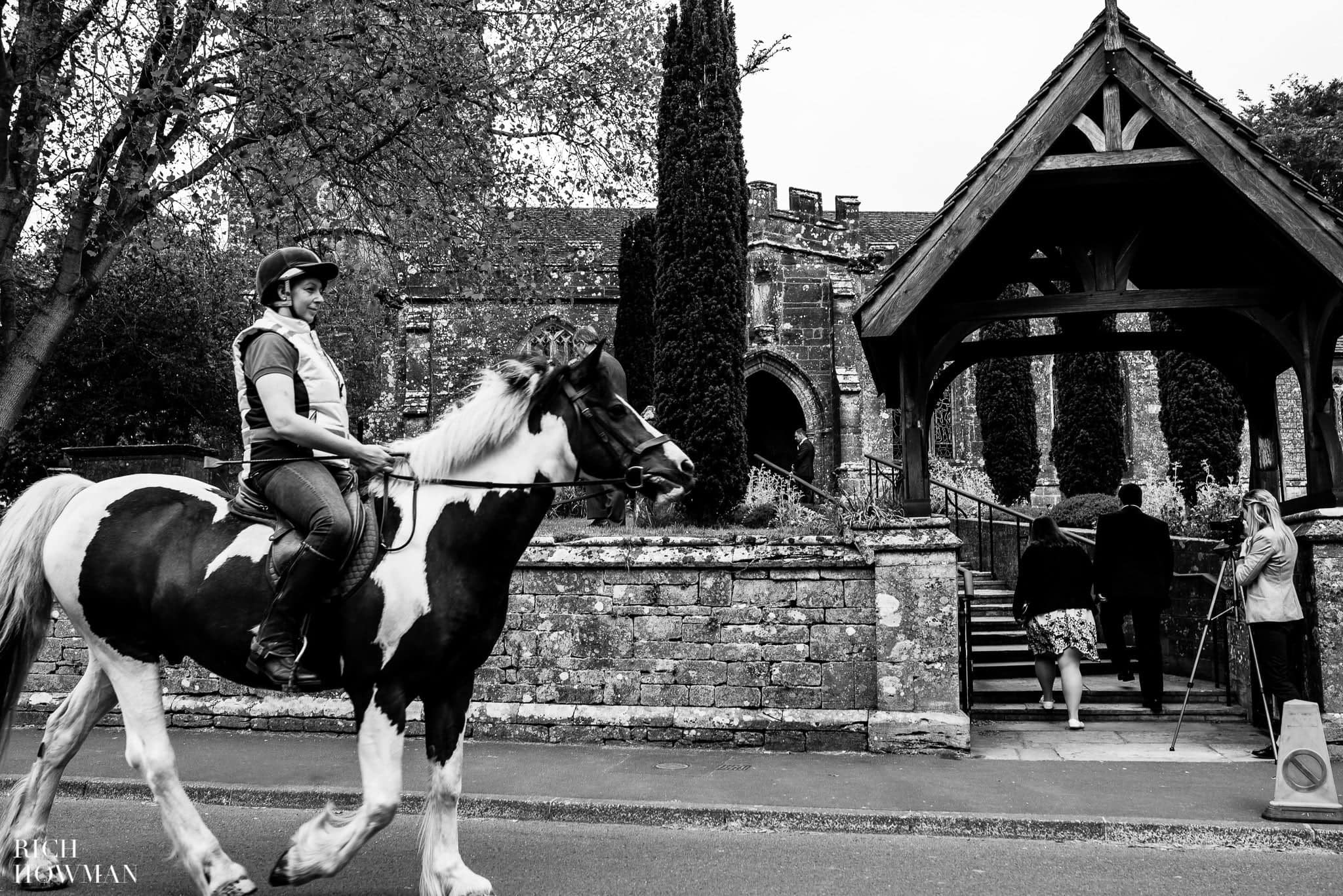 Horse wandering past the Church before the wedding ceremony