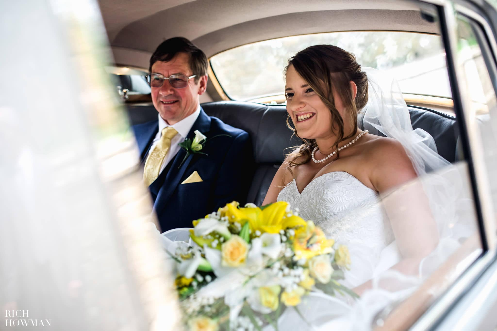 The bride and her father arriving in a white Mercedes at the Church before their wedding ceremony