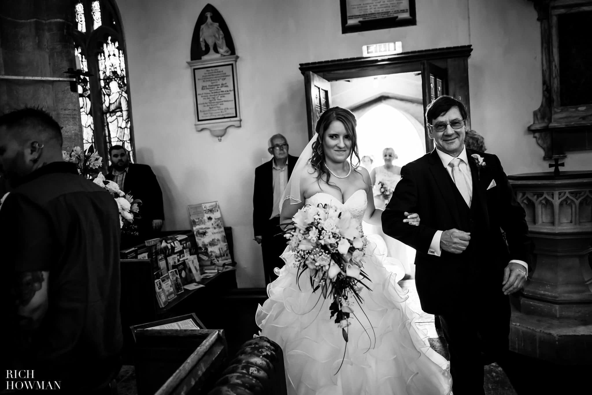 Documentary photograph of the bride and her father entering the church