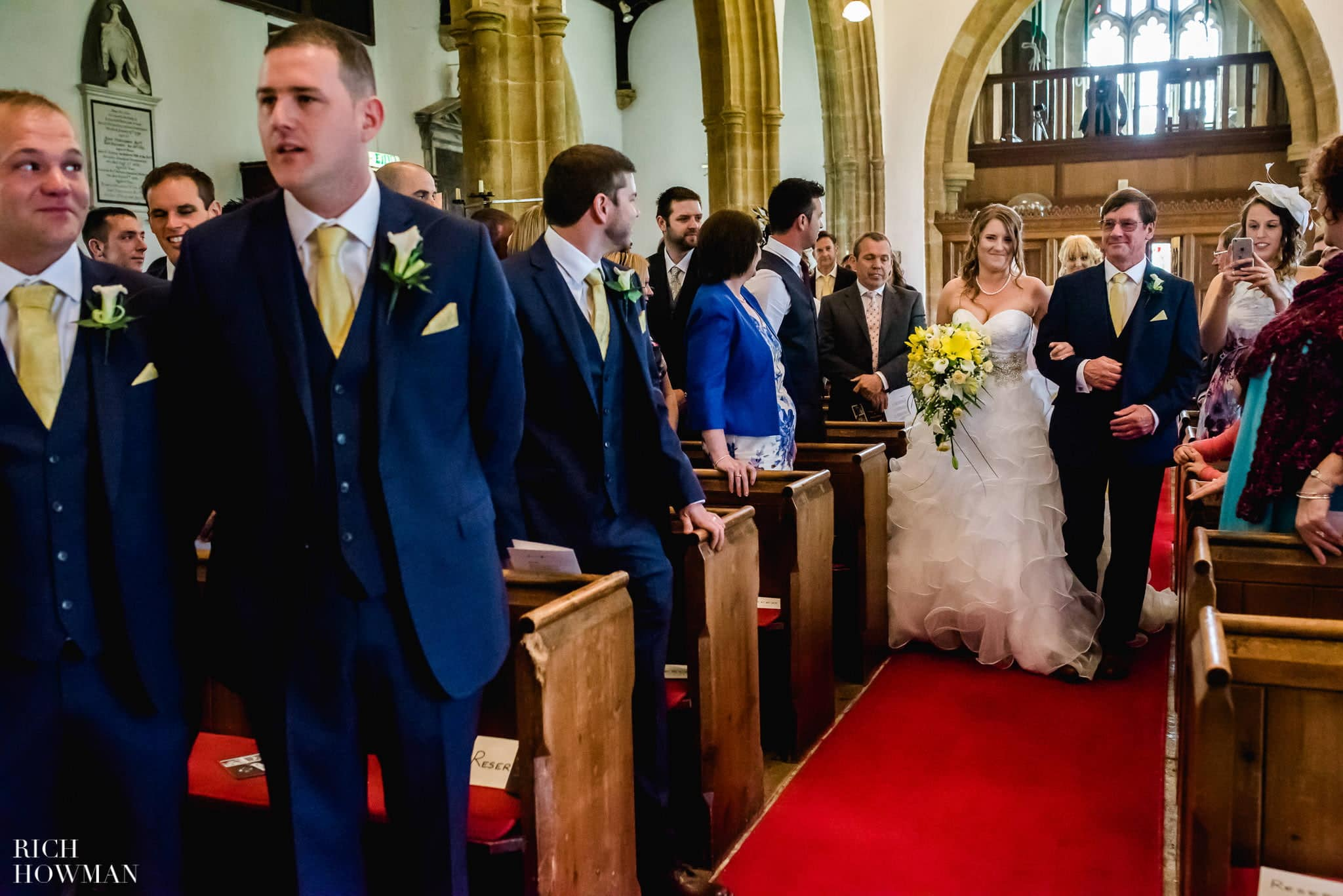 Walking up the aisle on her fathers arm to the waiting groom