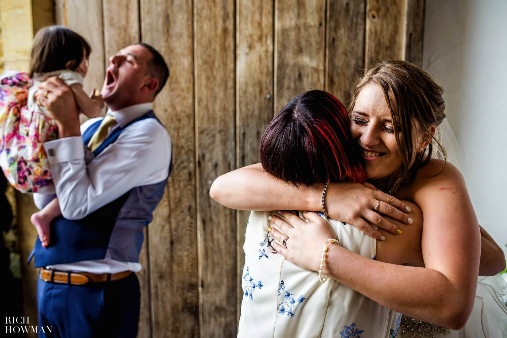 Emotional hugs in the receiving line at a wedding at Haselbury Mill