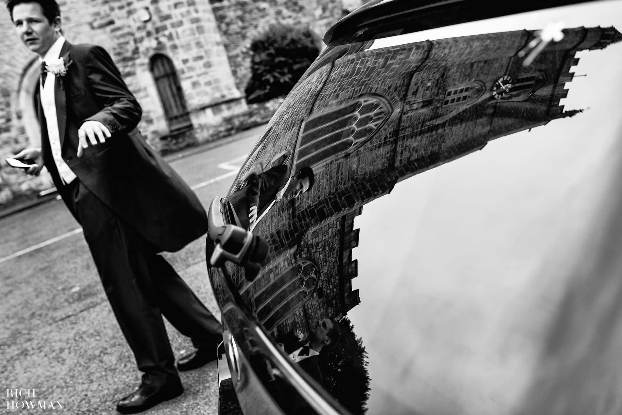 Black and white reflection on a car of Holy Trinity Church, Westbury-on-Trym