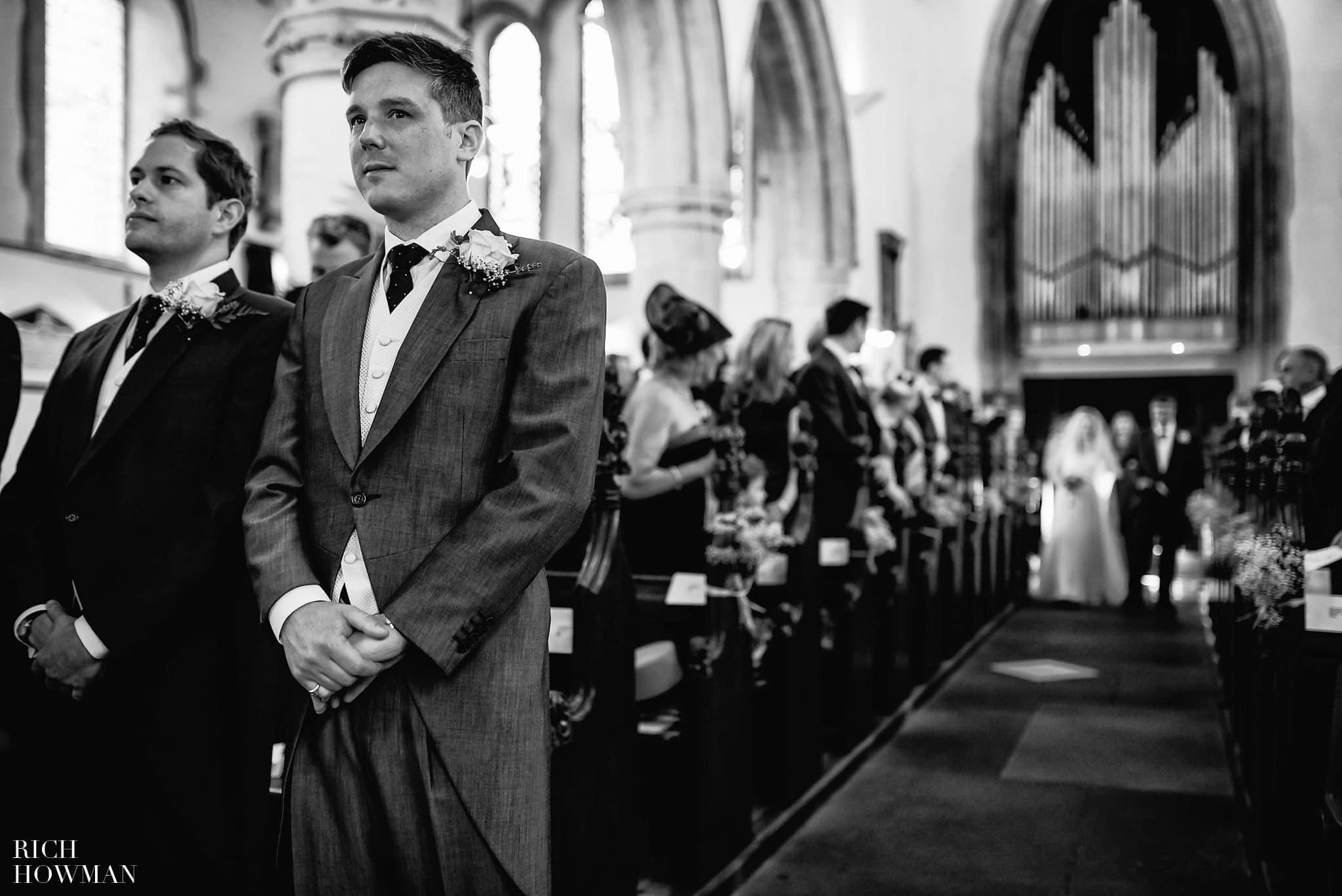 Bride walking down the aisle Holy Trinity Church Westbury-on-Trym Bristol