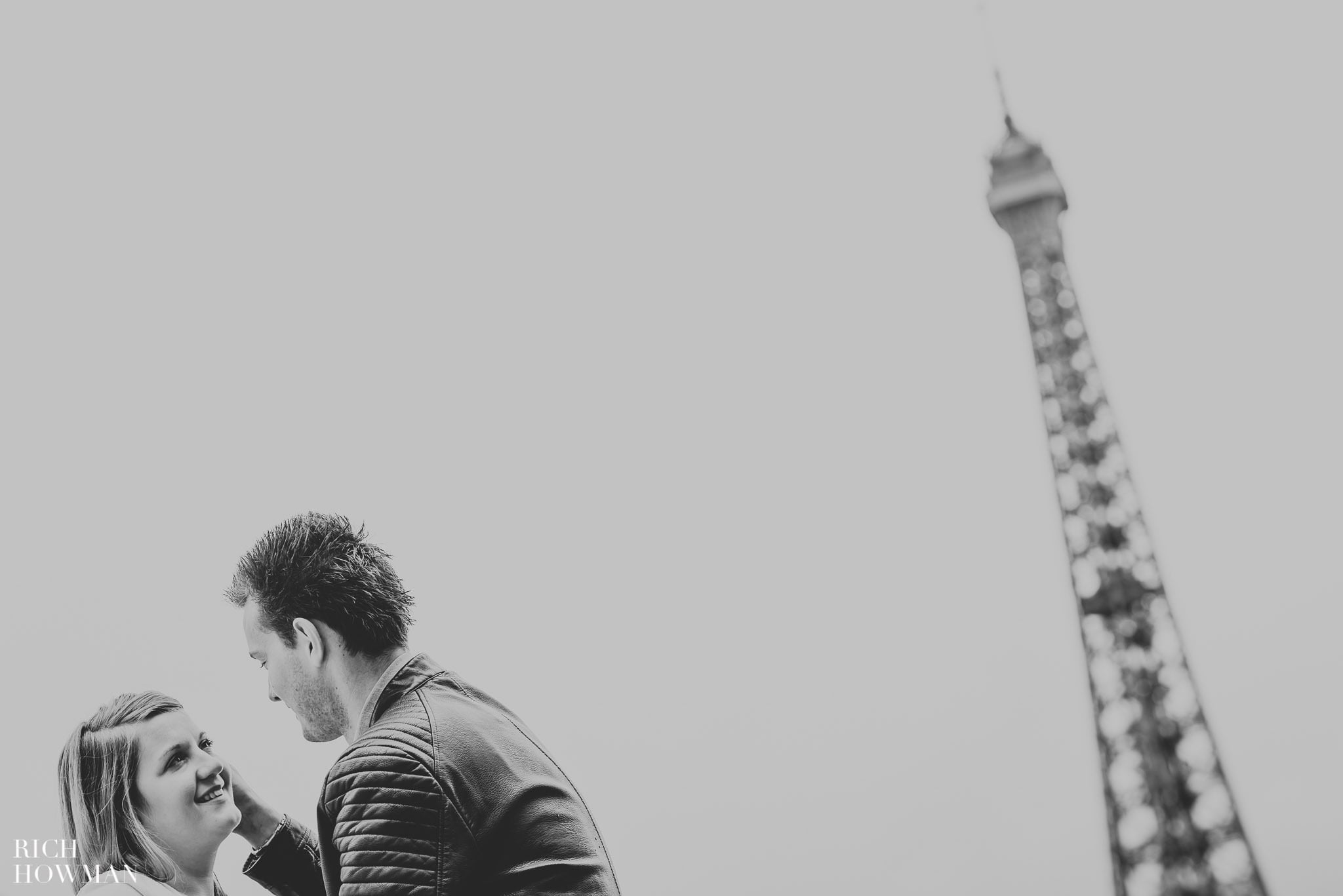 Black and white photograph of a couple at the Eiffel Tower, Paris