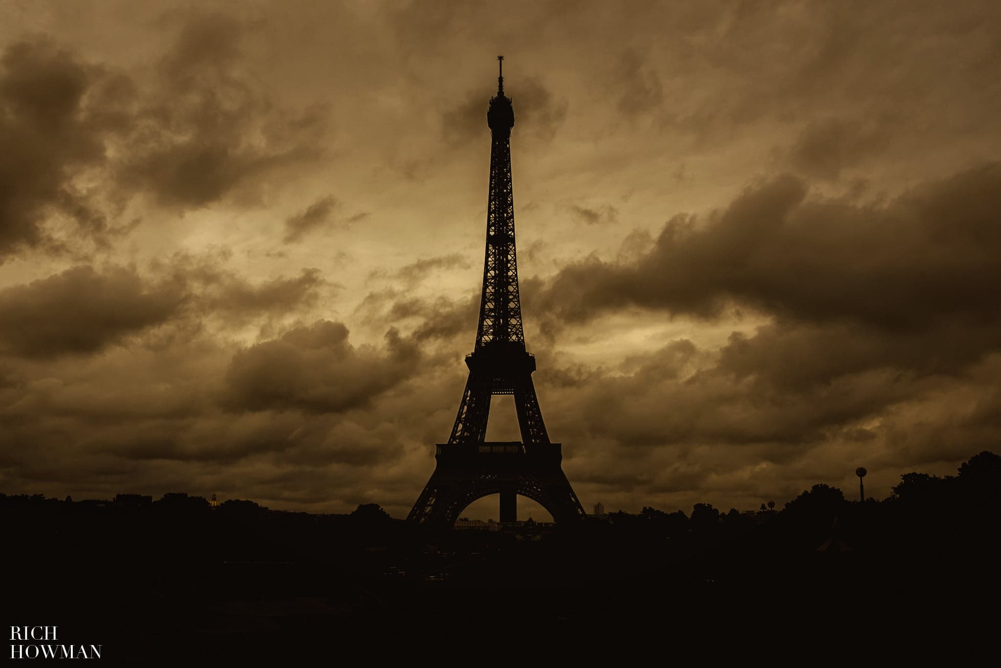 Eiffel tower in the clouds and rain