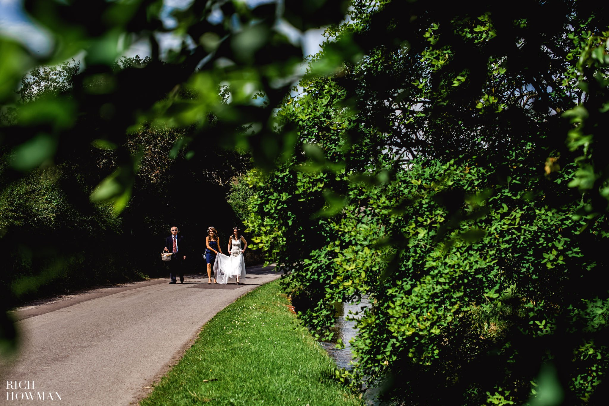 Photograph of the bride making her way along the road to the Church from Howards House Hotel