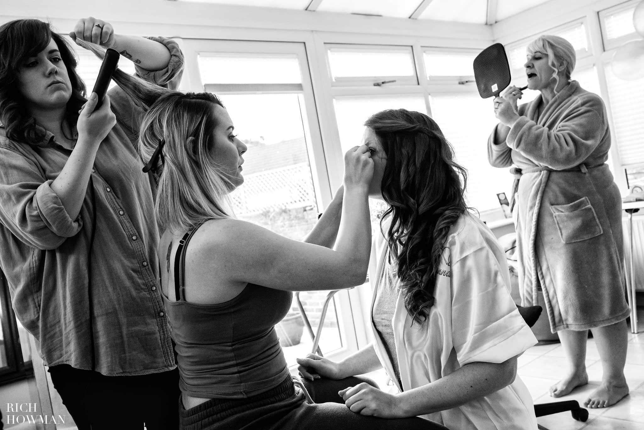 Black and white documentary wedding photography of bridal preparations on the morning of a wedding at the Bishops Palace in Somerset