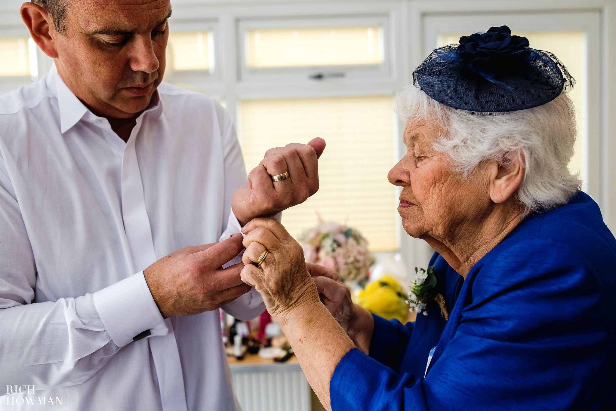Brides Grandmother helping her son (the Brides father) do up his cufflinks on the morning of the wedding
