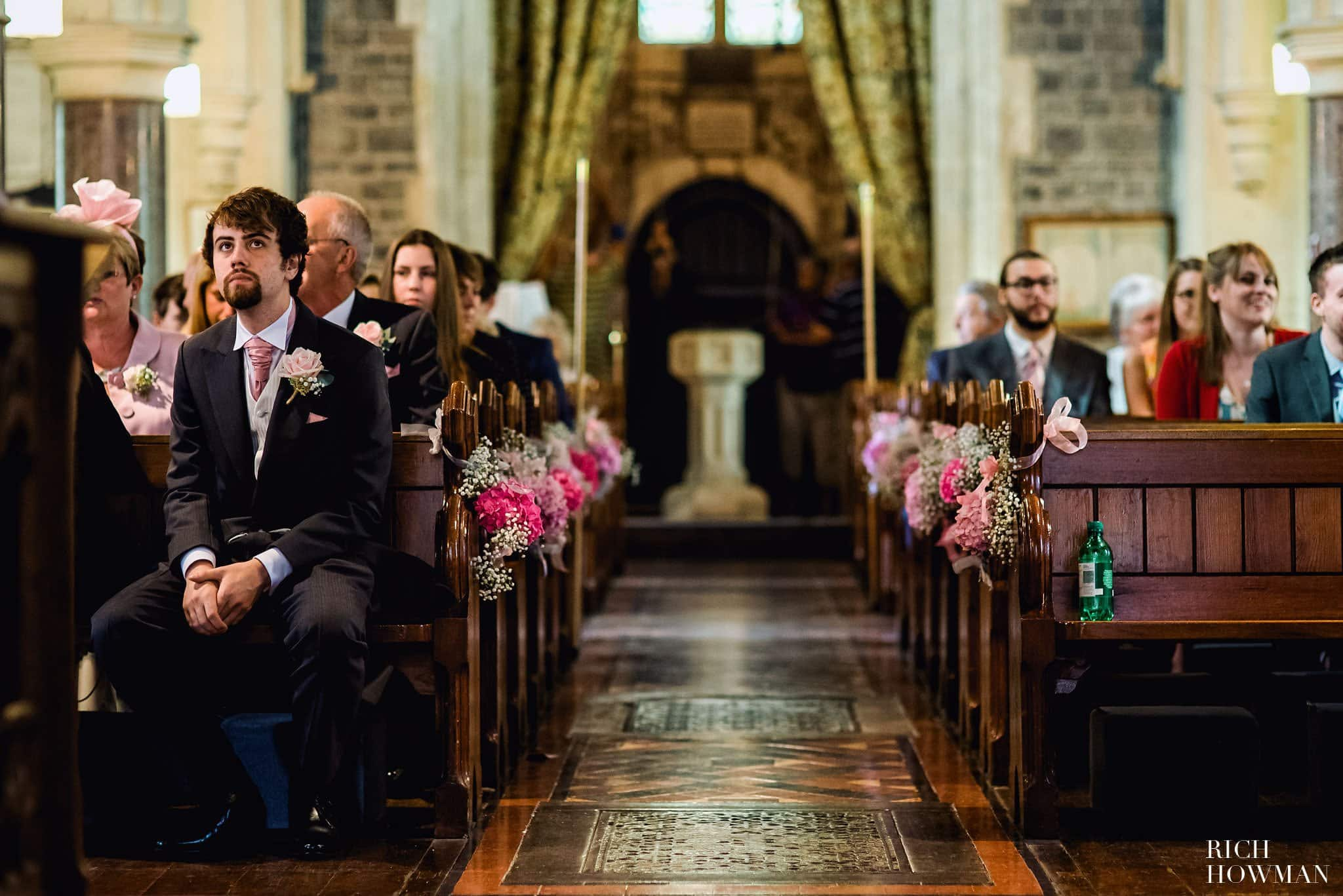 The Groom waits inside St. James' Church in Ashwick before his wedding