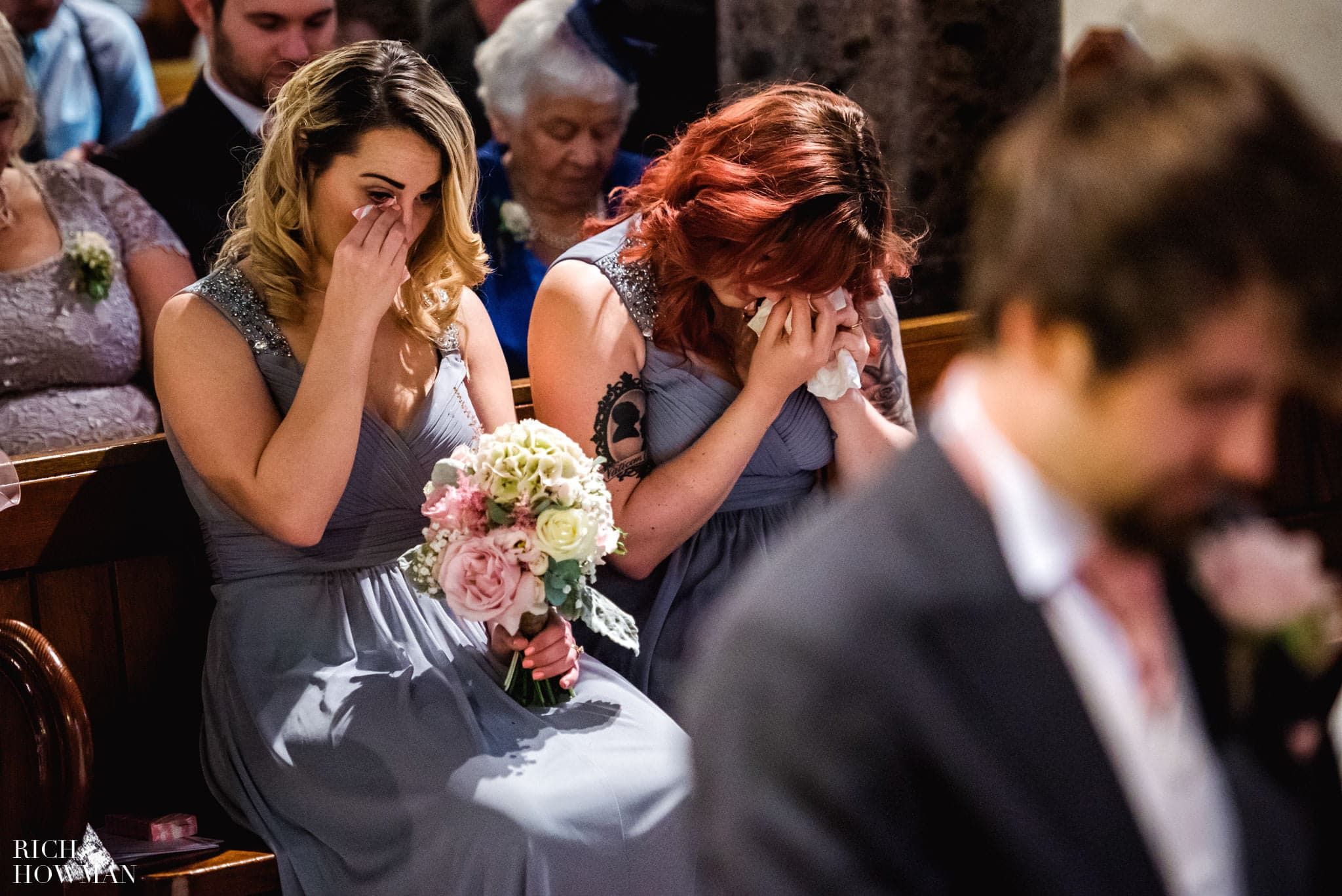 Bridesmaids crying in church