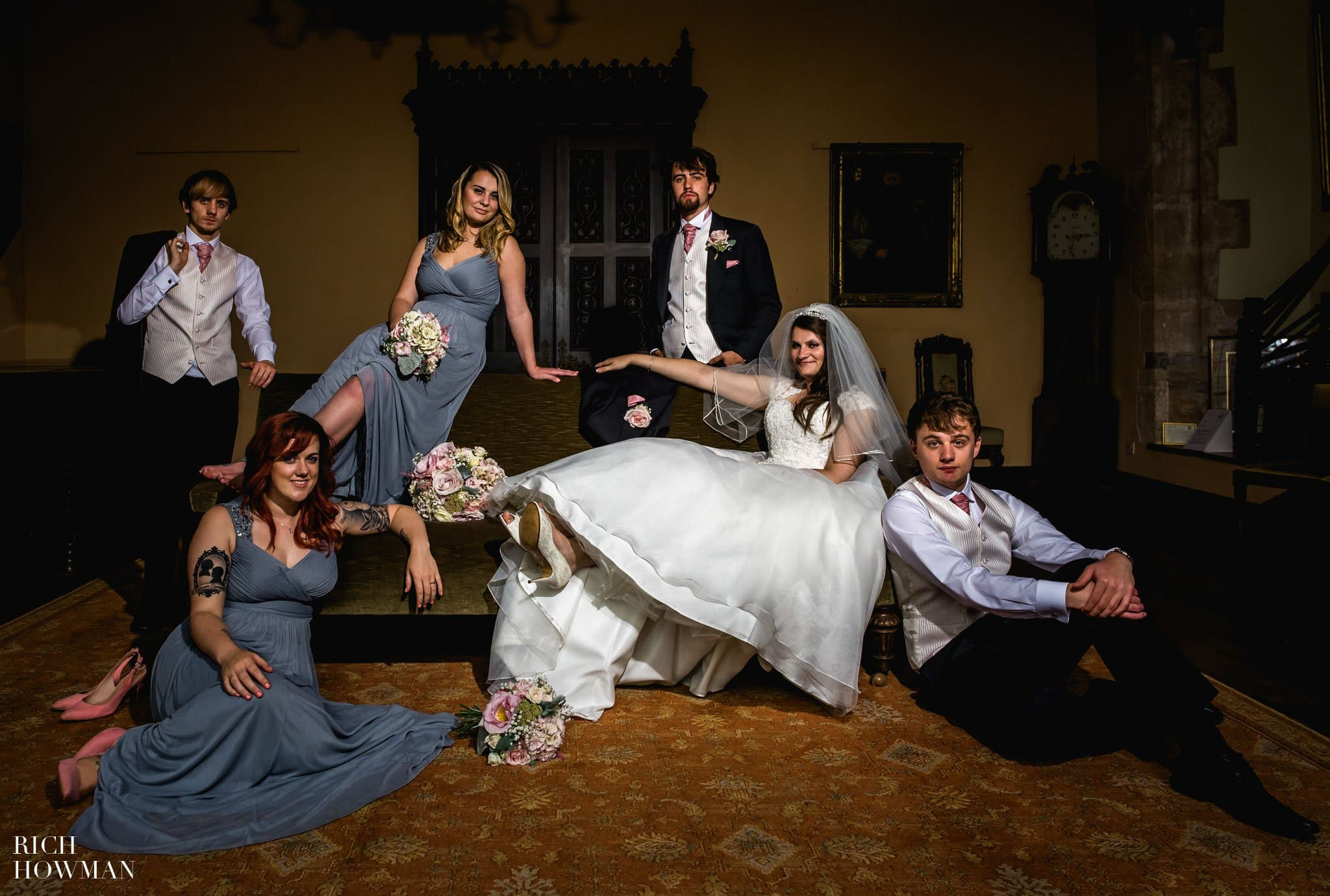 Relaxed wedding photo of the bridal party at the Bishops Palace Wells