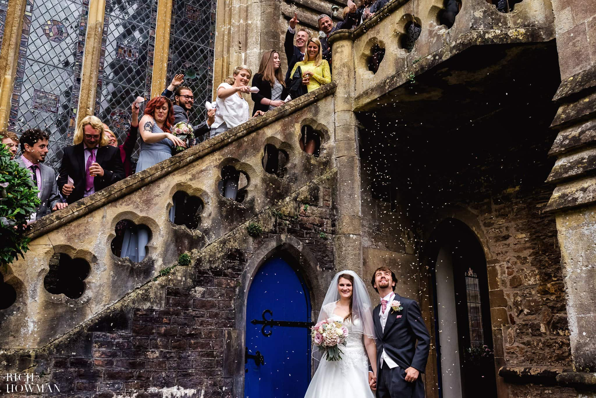 Confetti being thrown from the staircase at the Bishops Palace over the Bride and Groom