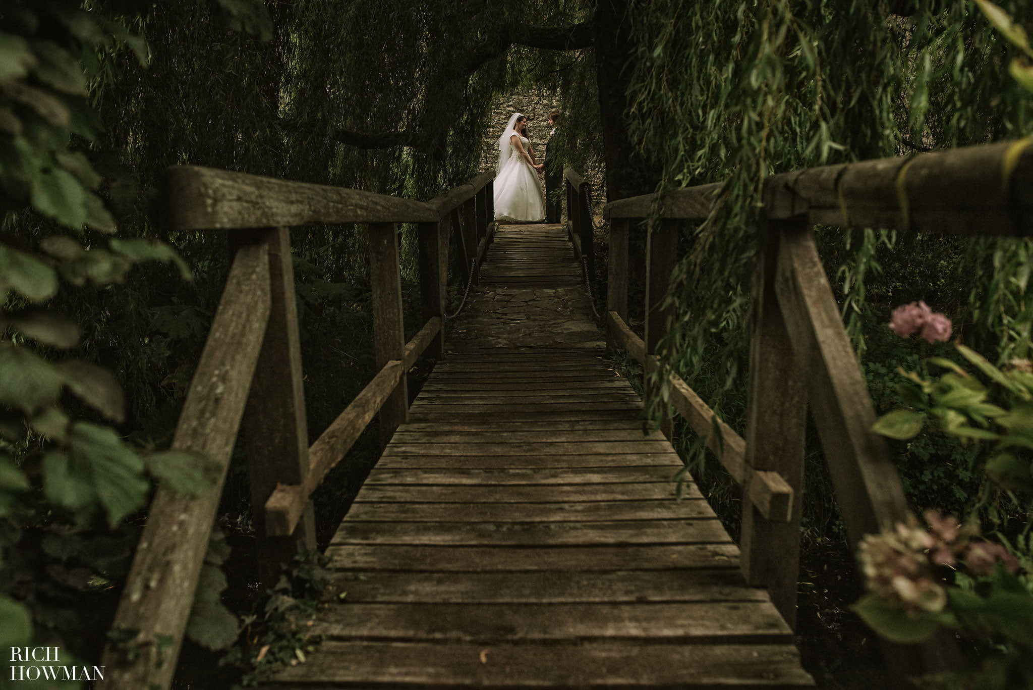Creative wedding photograph in the trees
