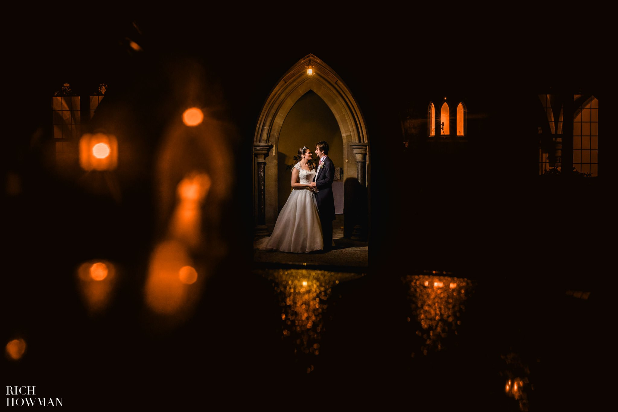 Creative portrait photograph of the bride and groom with light reflections