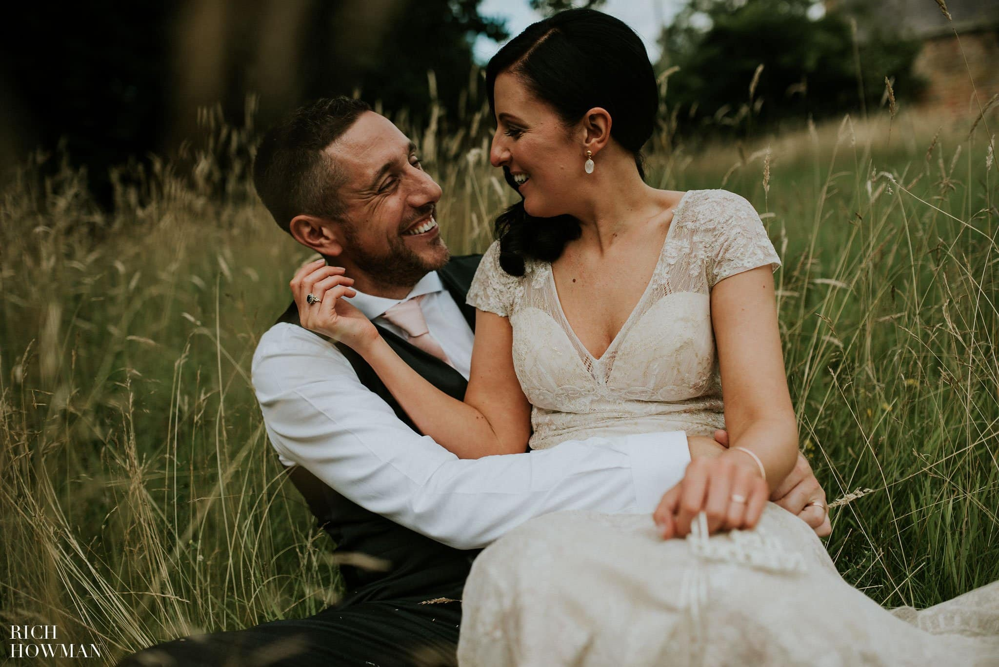 Newlywed couple laughing in a photograph at their Iscoyd Park Wedding