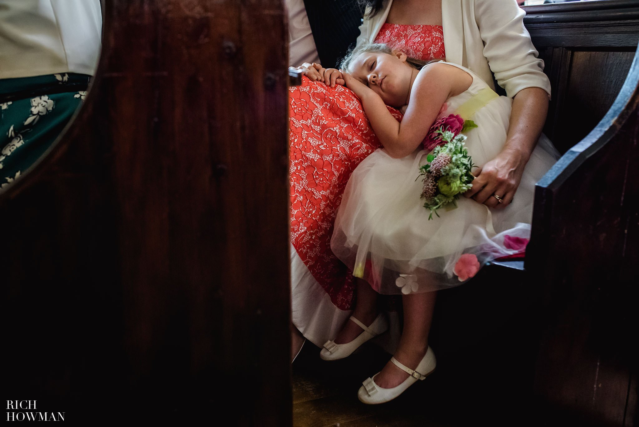 Little bridesmaid falling asleep in Church