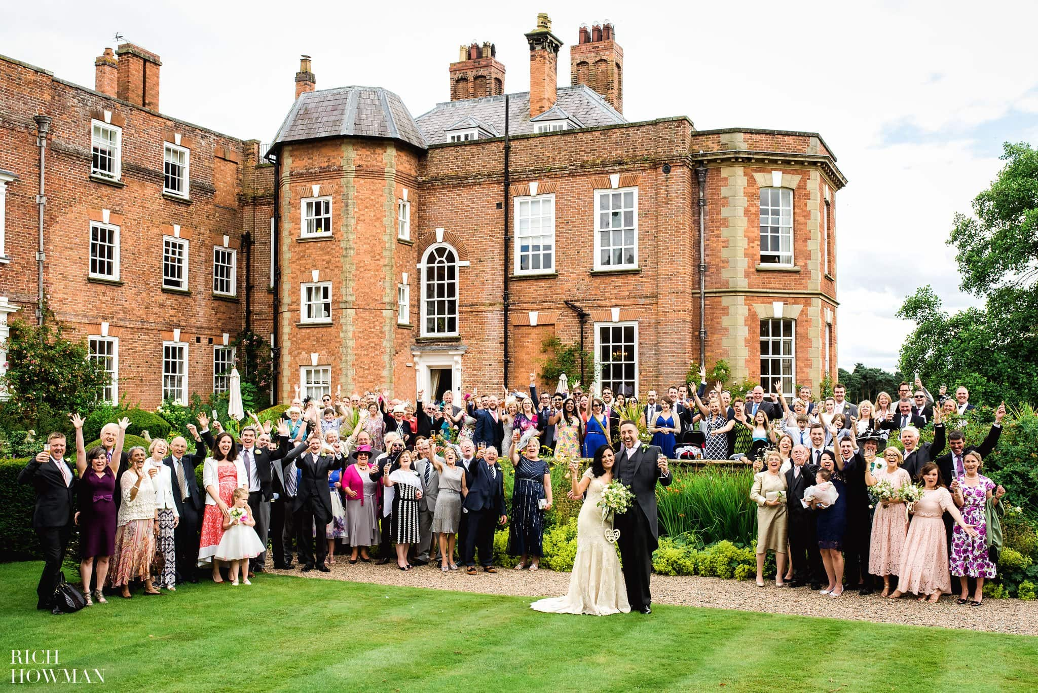 Group photo of everyone outside the back of the main house during this Iscoyd Park wedding