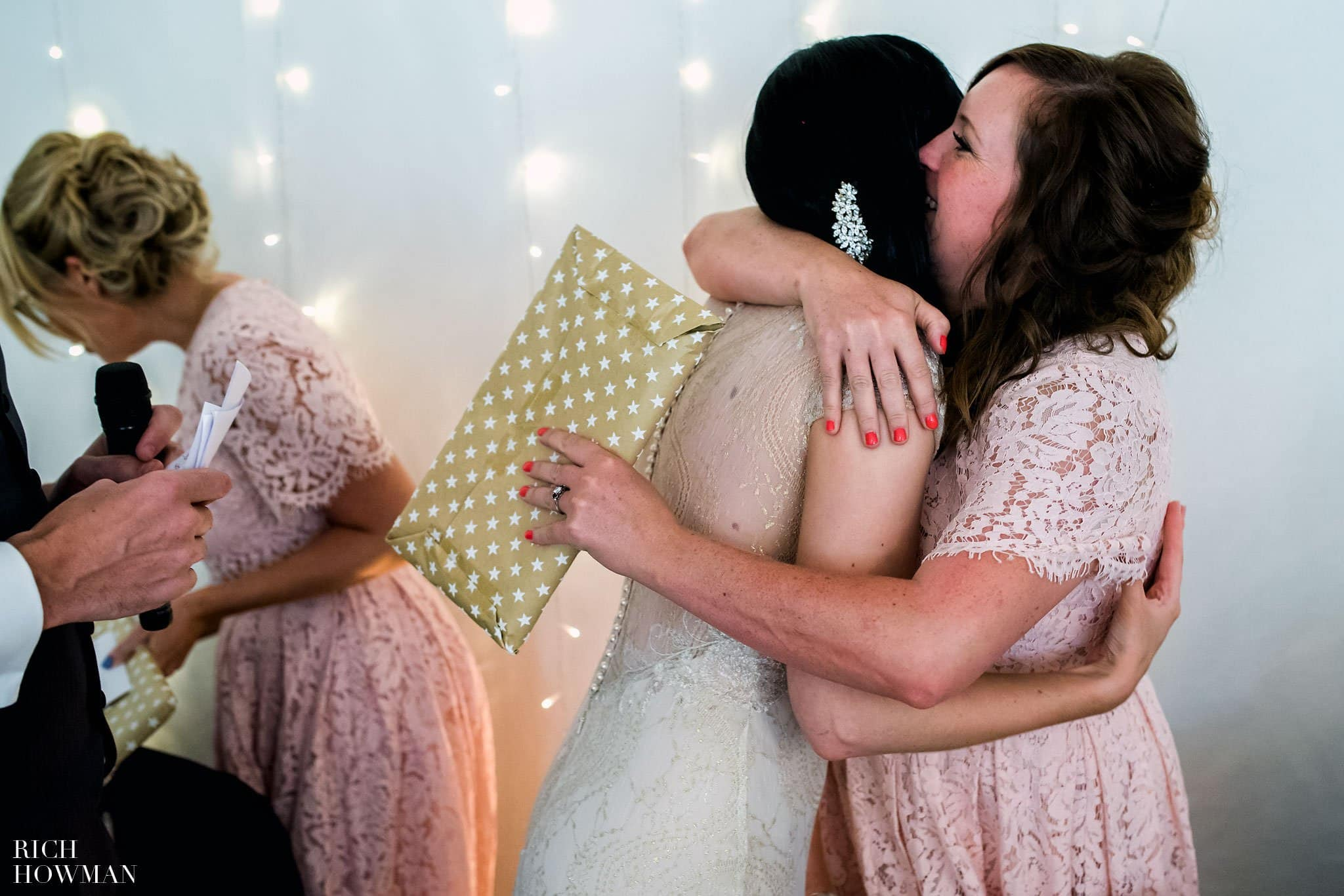 Bride hugging her bridesmaids after the wedding speeches