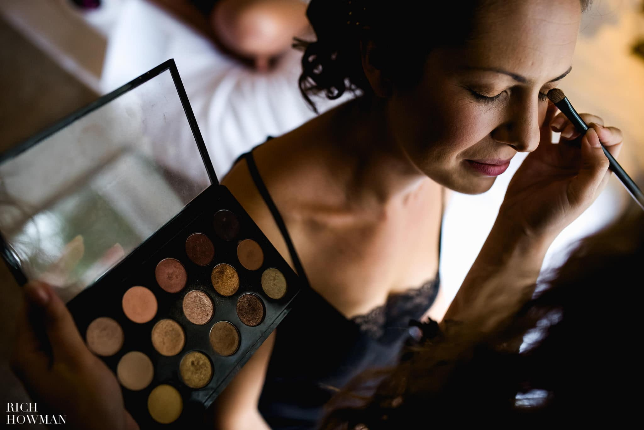 shallow depth of field photo of bride with makeup artist at the Coach and Horses in Kew, London