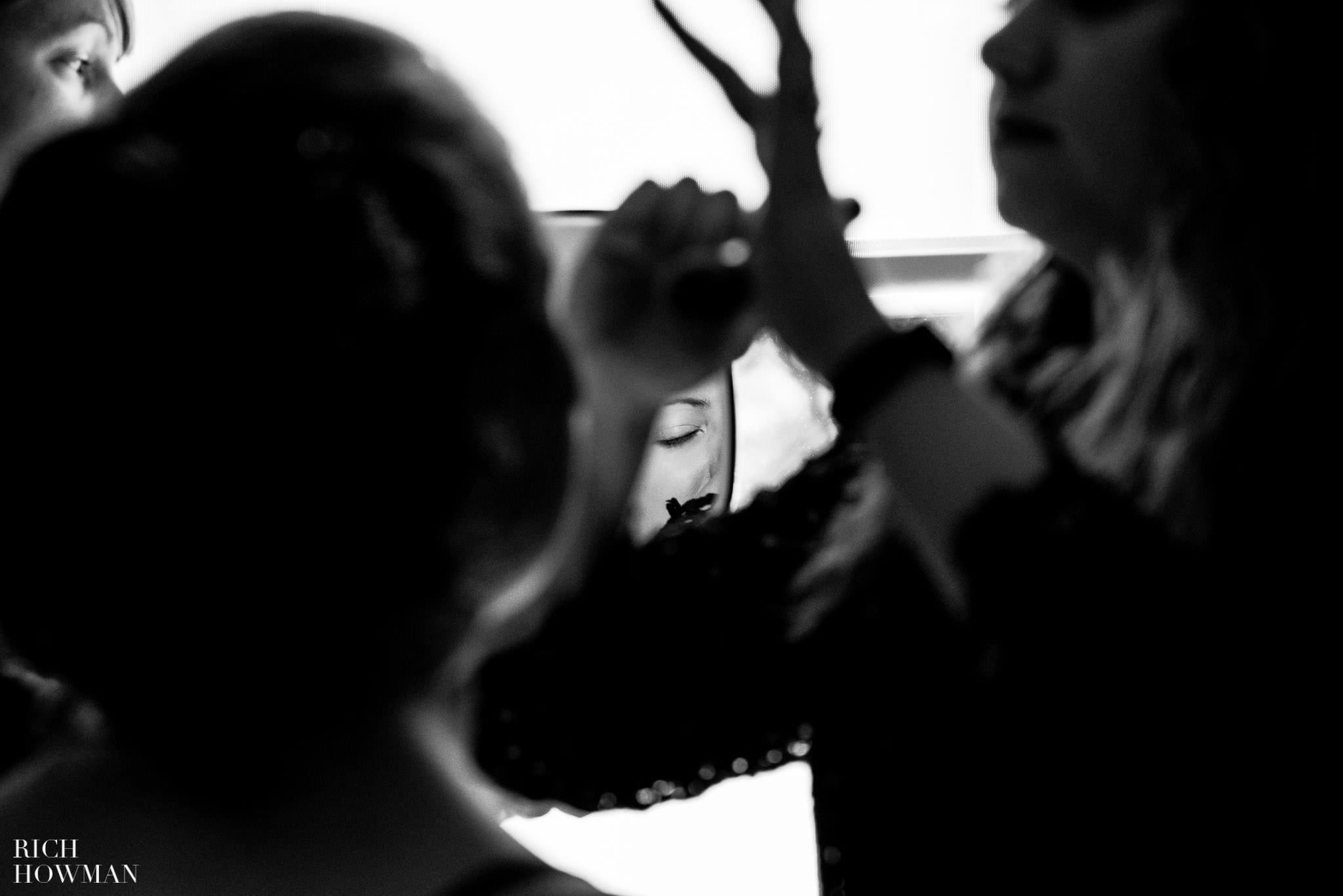 Reportage wedding photo. The brides eye isolated in a mirror.