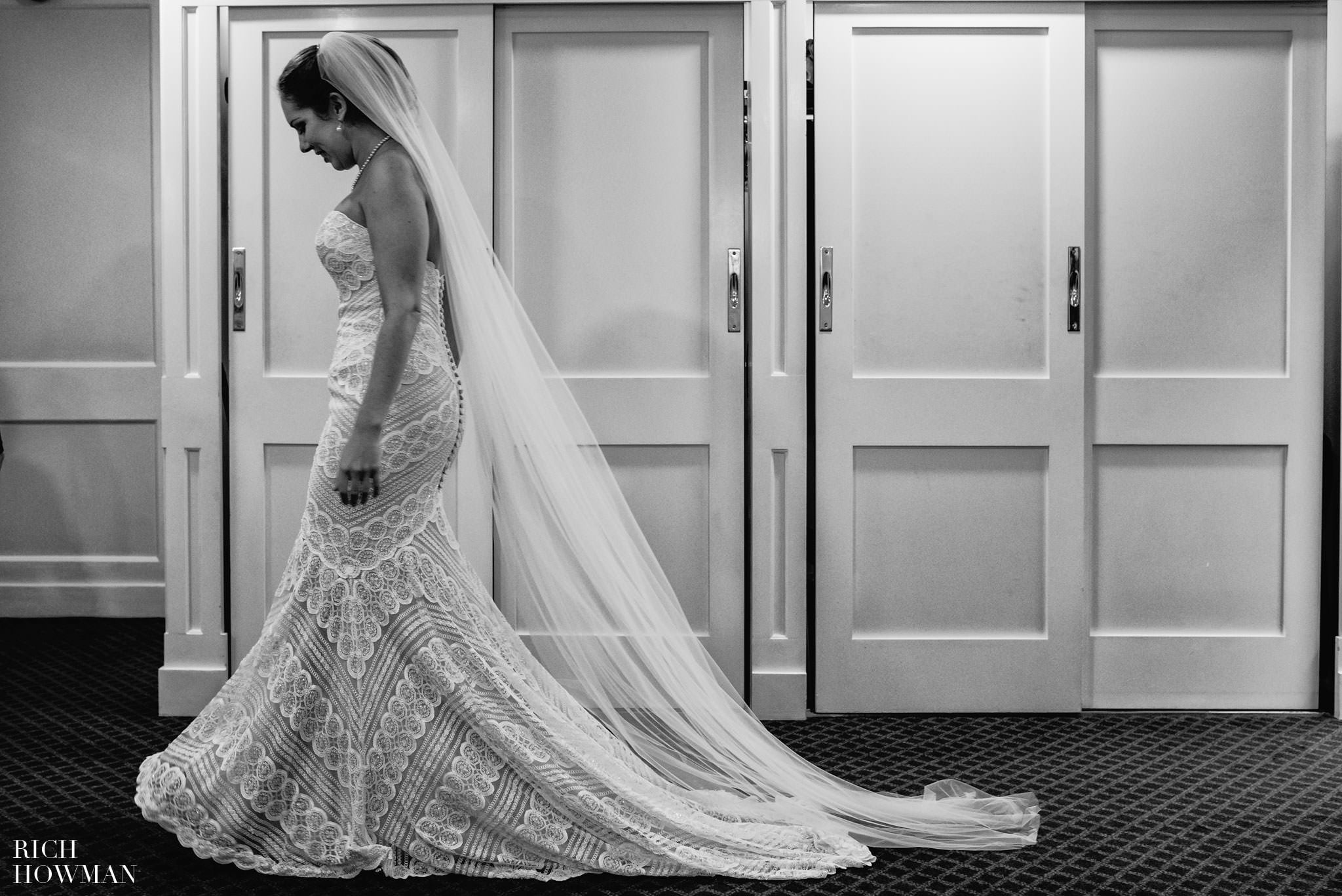 The brides amazing wedding dress, photographed in black and white at Cambridge Cottage.
