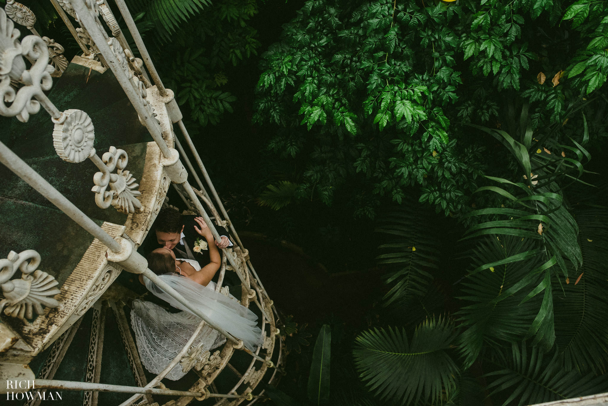 Looking down on the newlyweds standing on the spiral staircase at Kew Gardens