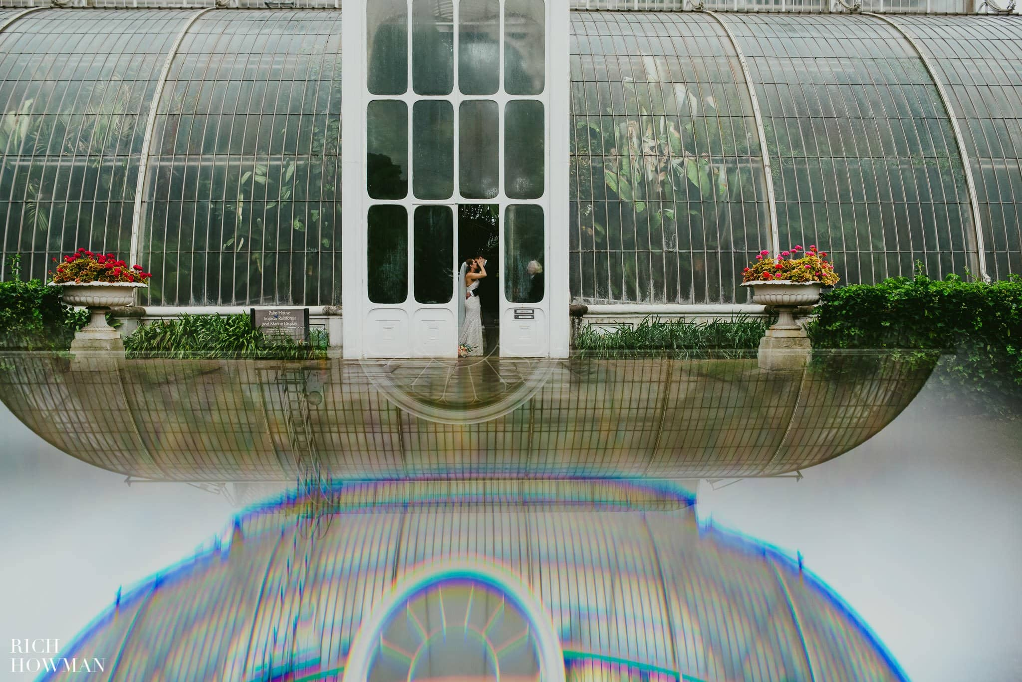 Wedding photo at Kew Gardens reflecting the Palm House with a prism
