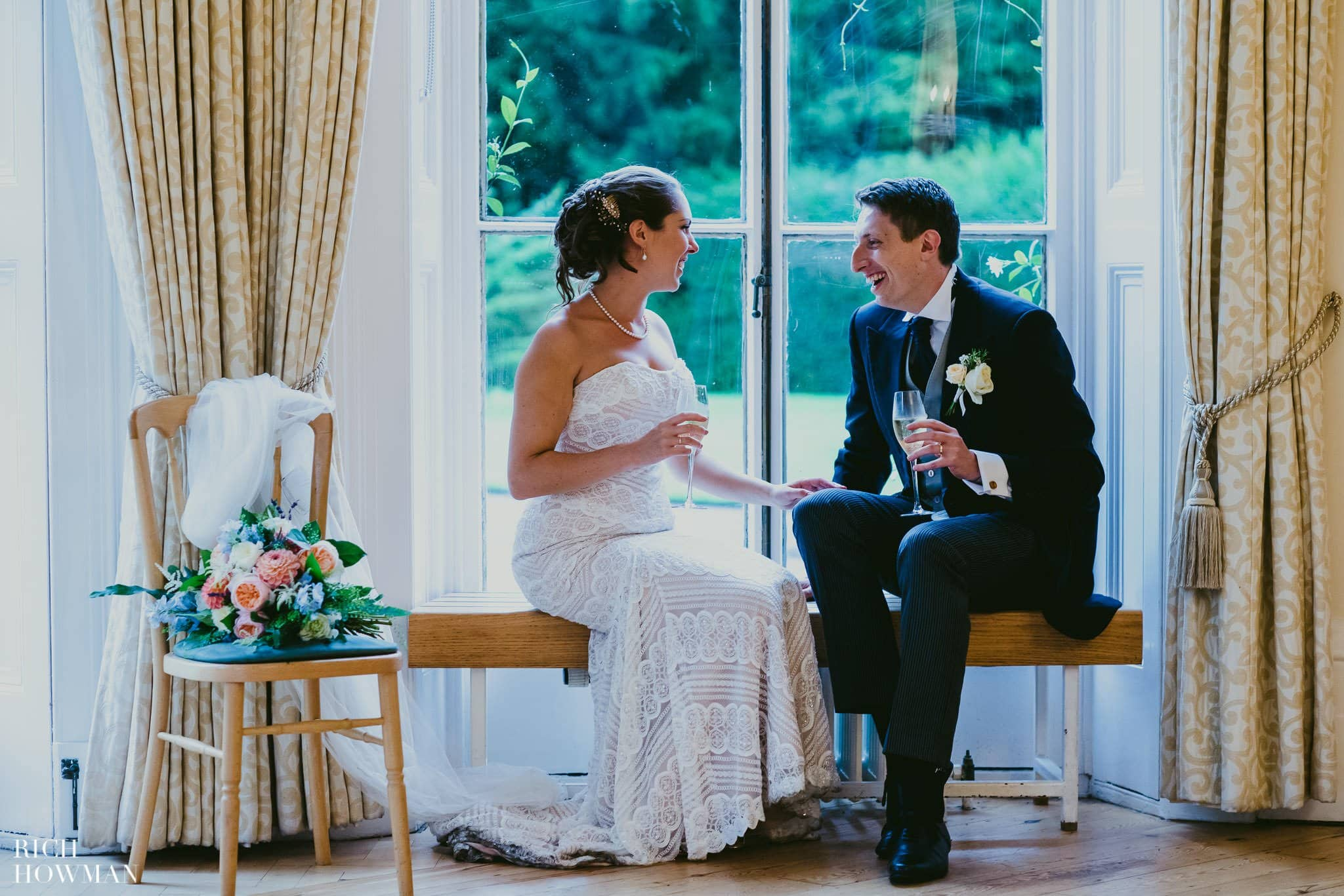 Enjoying a drink together in the ceremony room at Cambridge Cottage.