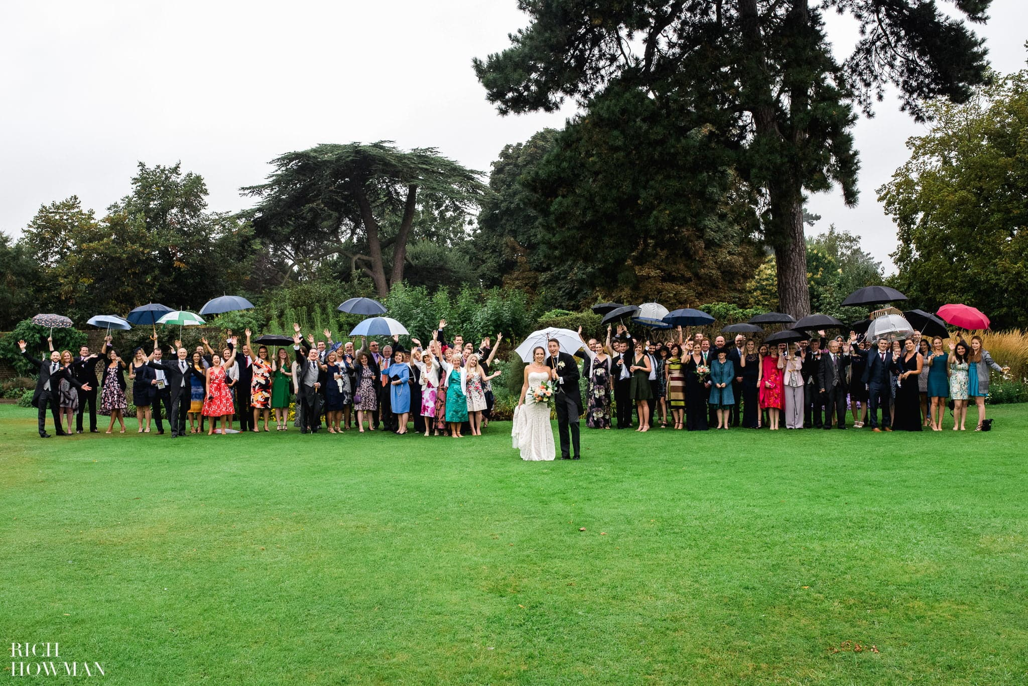 Wedding Group Photograph in the Rain at Kew Gardens