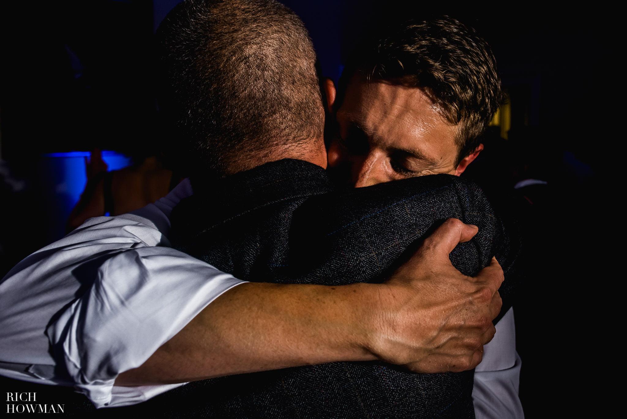Emotional hug during a wedding at Kew Gardens.