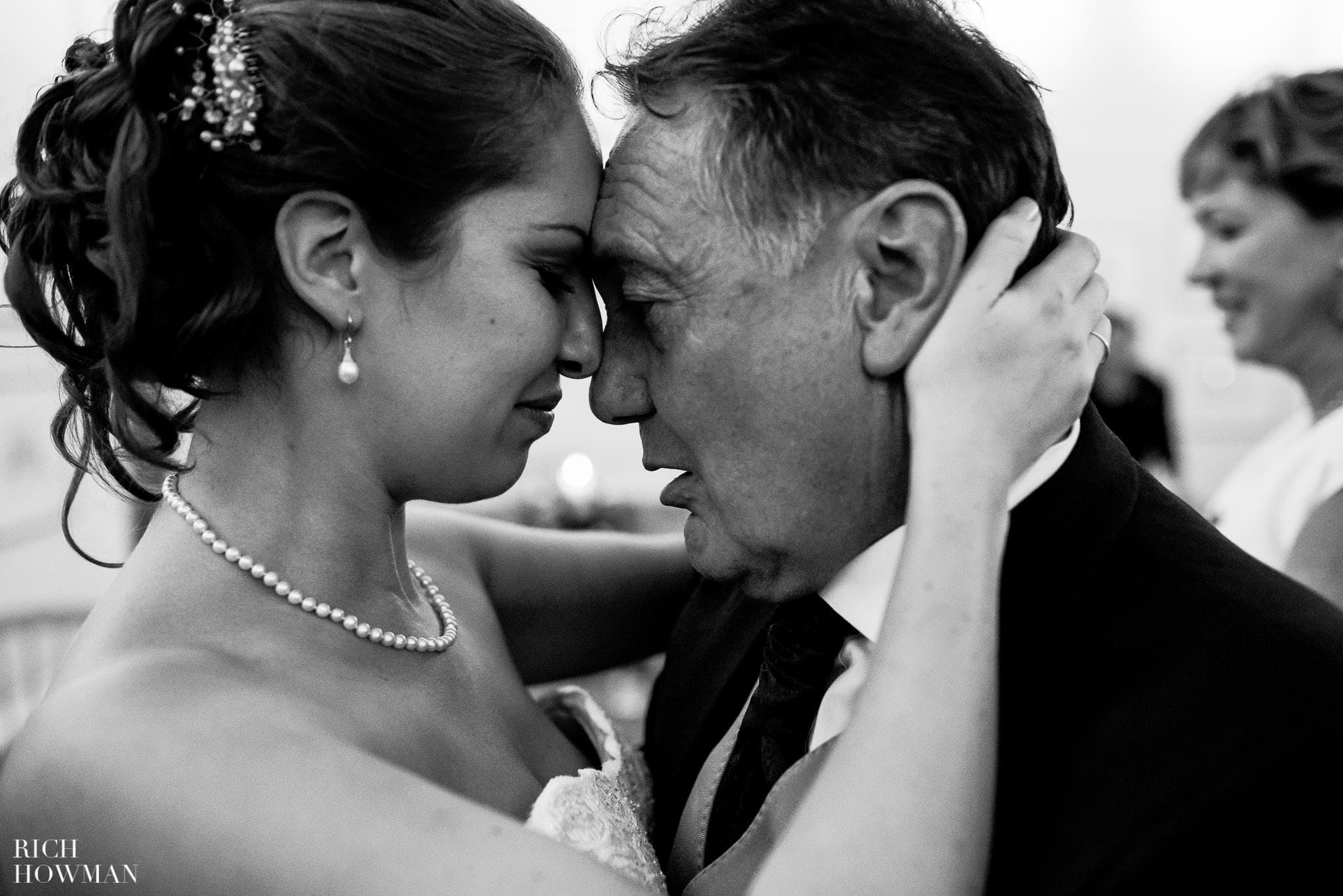 Emotional black and white photograph of the bride and her father