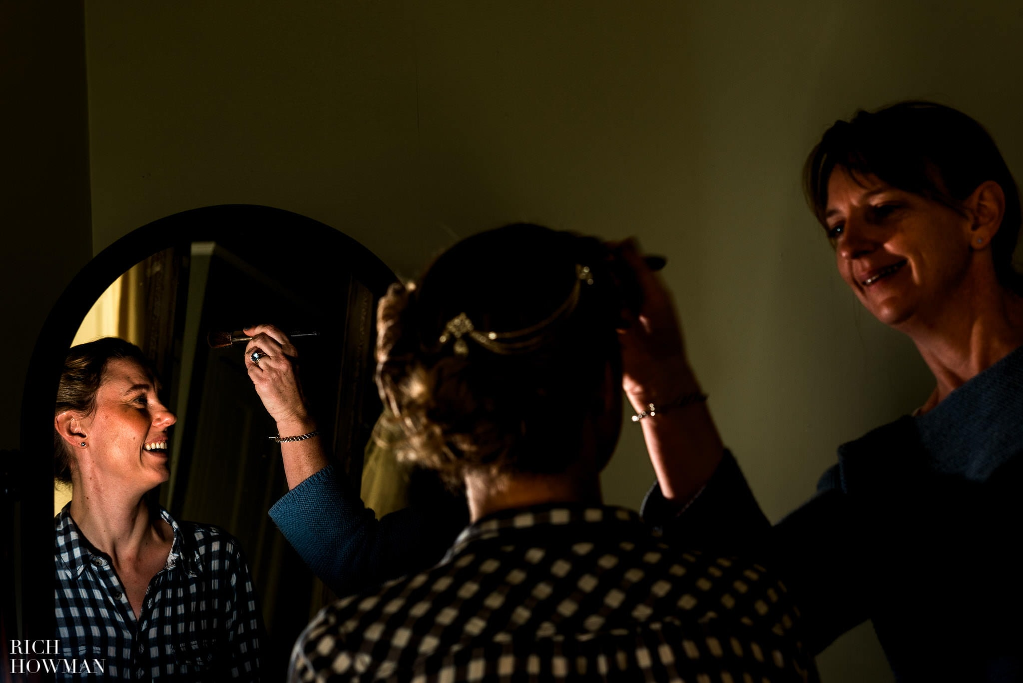 Make up artist working on the bride at Pennard House