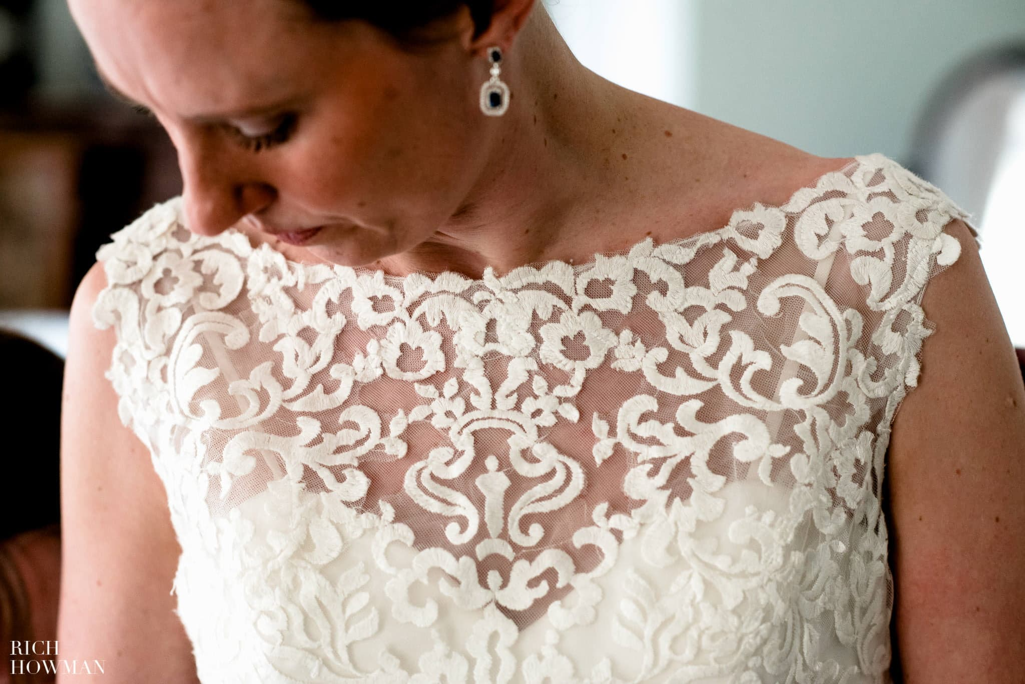 Detail photo of the brides lace wedding dress