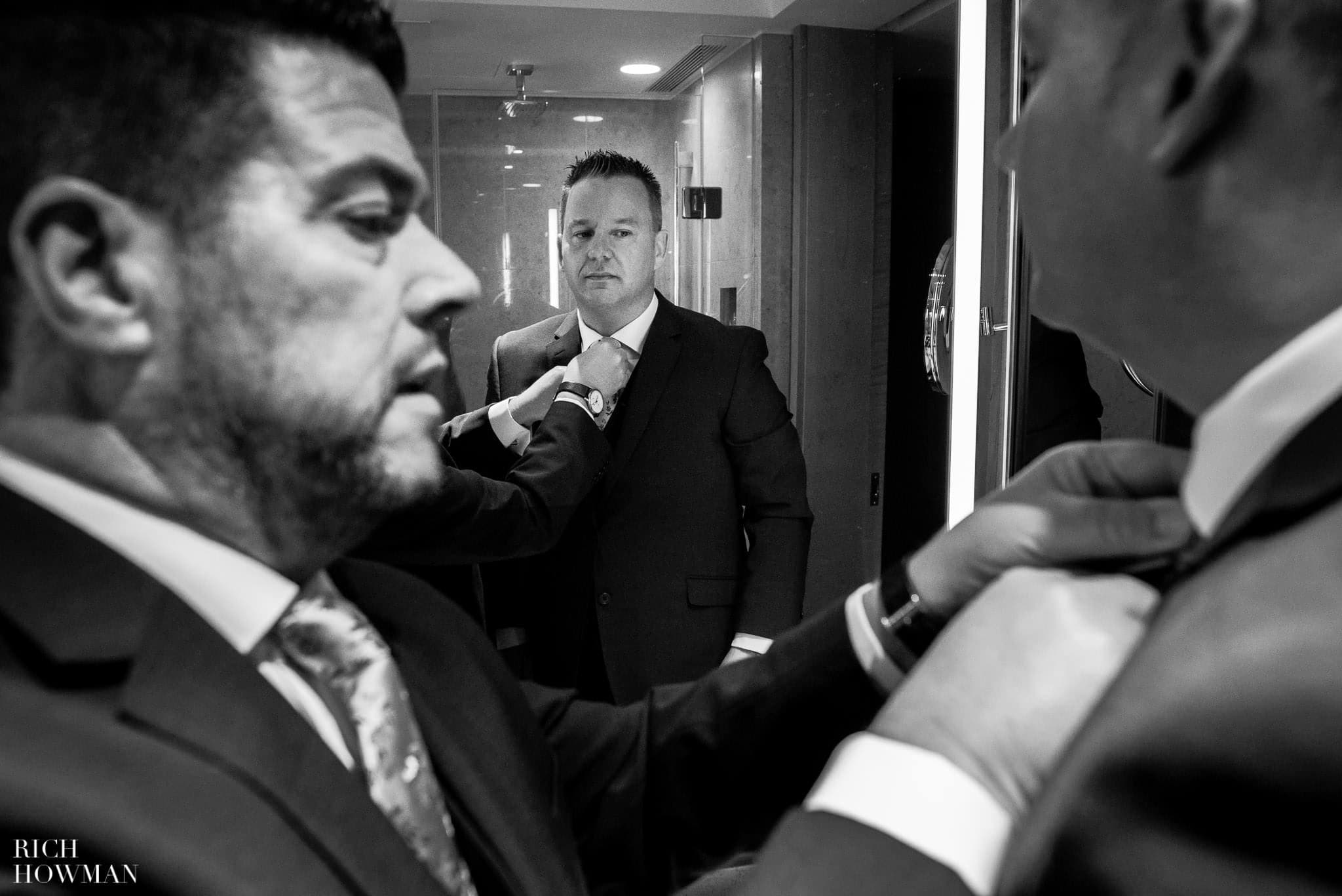 Grooms getting ready before their gay wedding in London at the Shangra-la Shard