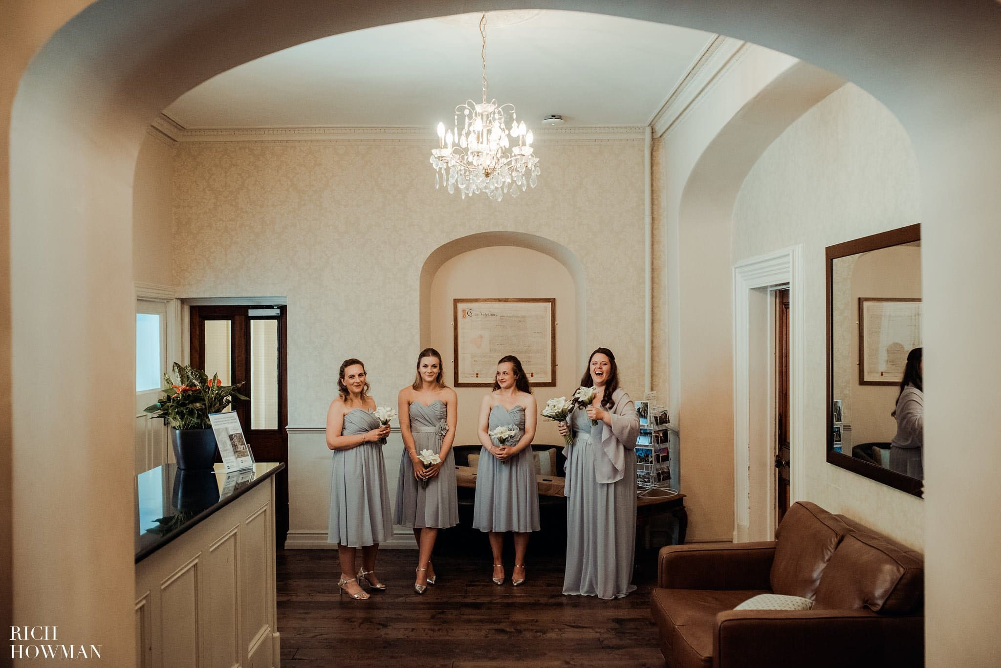 Bridesmaids waiting for the bride prior to her wedding in the lobby of Leigh Park Hotel