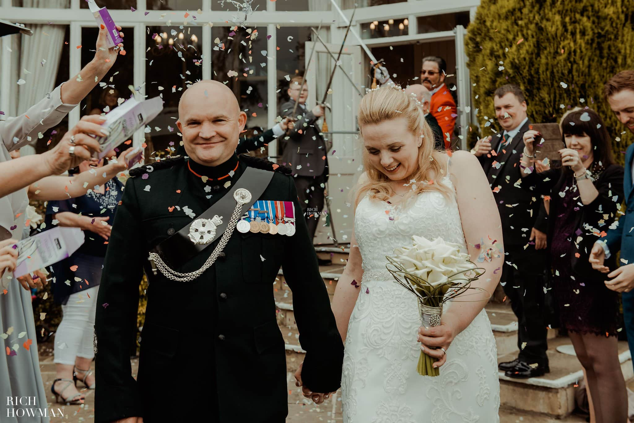 Wedding Photographer photographing confetti at the Leigh Park Hotel