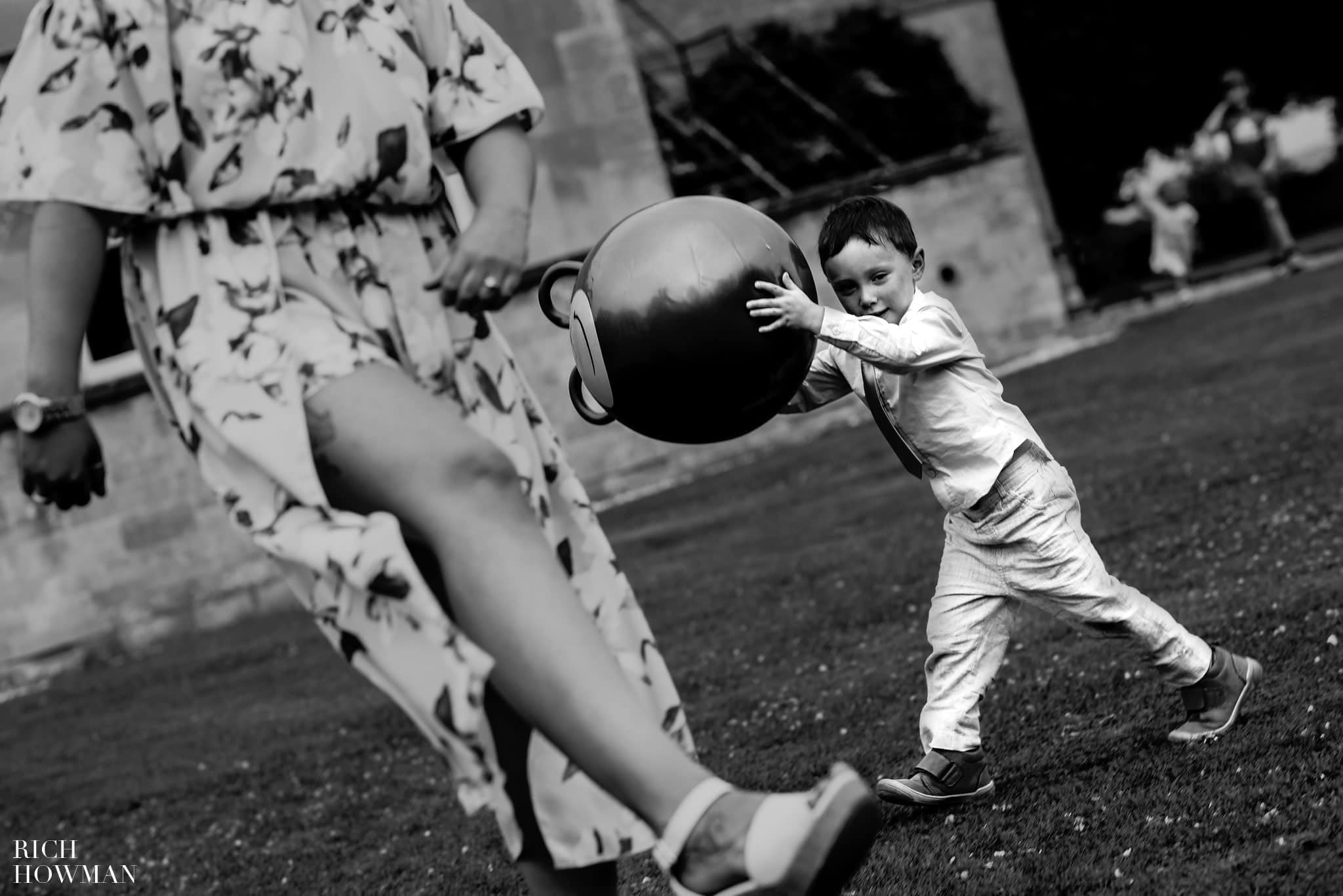 A little boy plays with a space hopper during a wedding at the Leigh Park Hotel in Bradford on Avon in Wiltshire