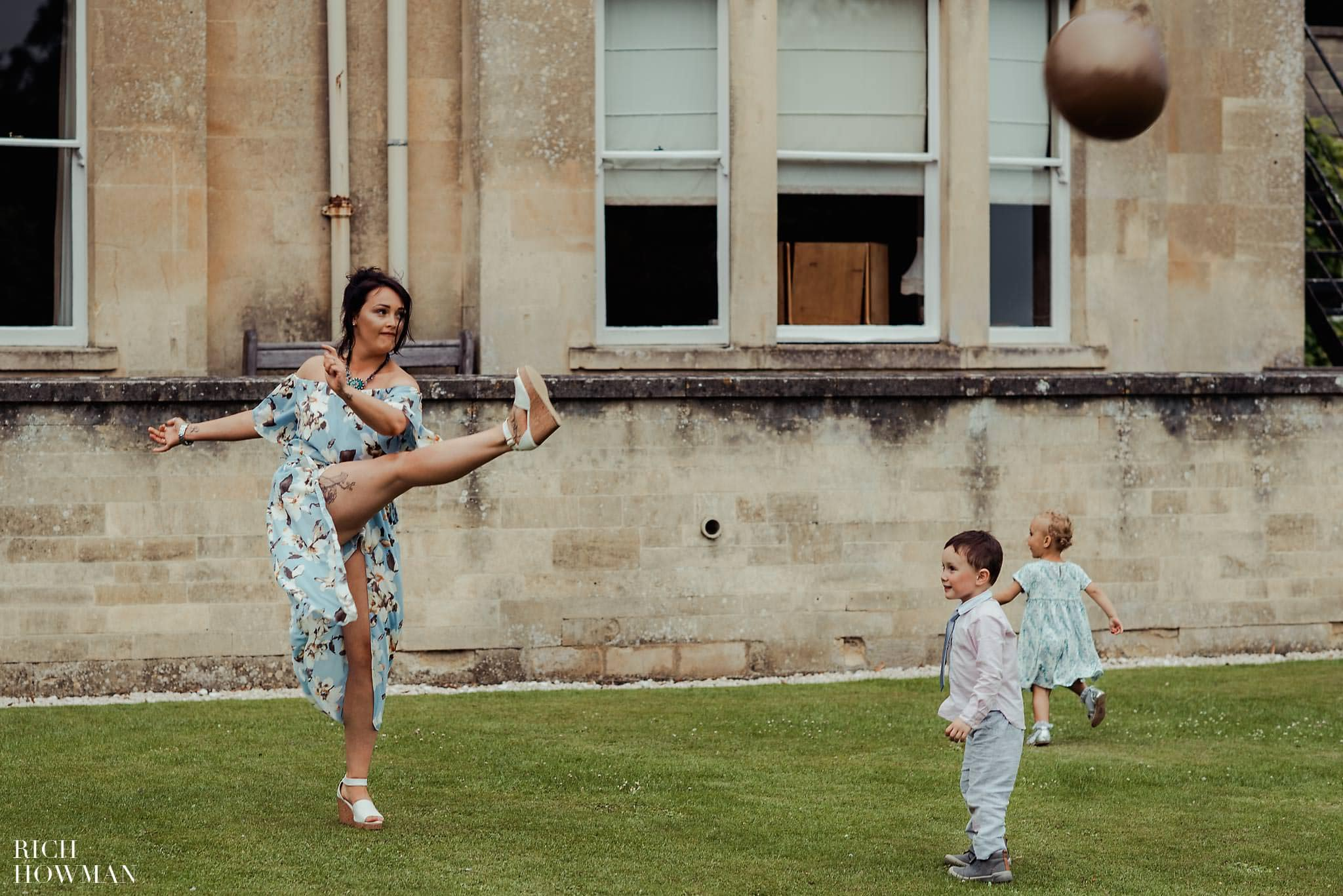 Photo of a wedding guests kicking a space hopper